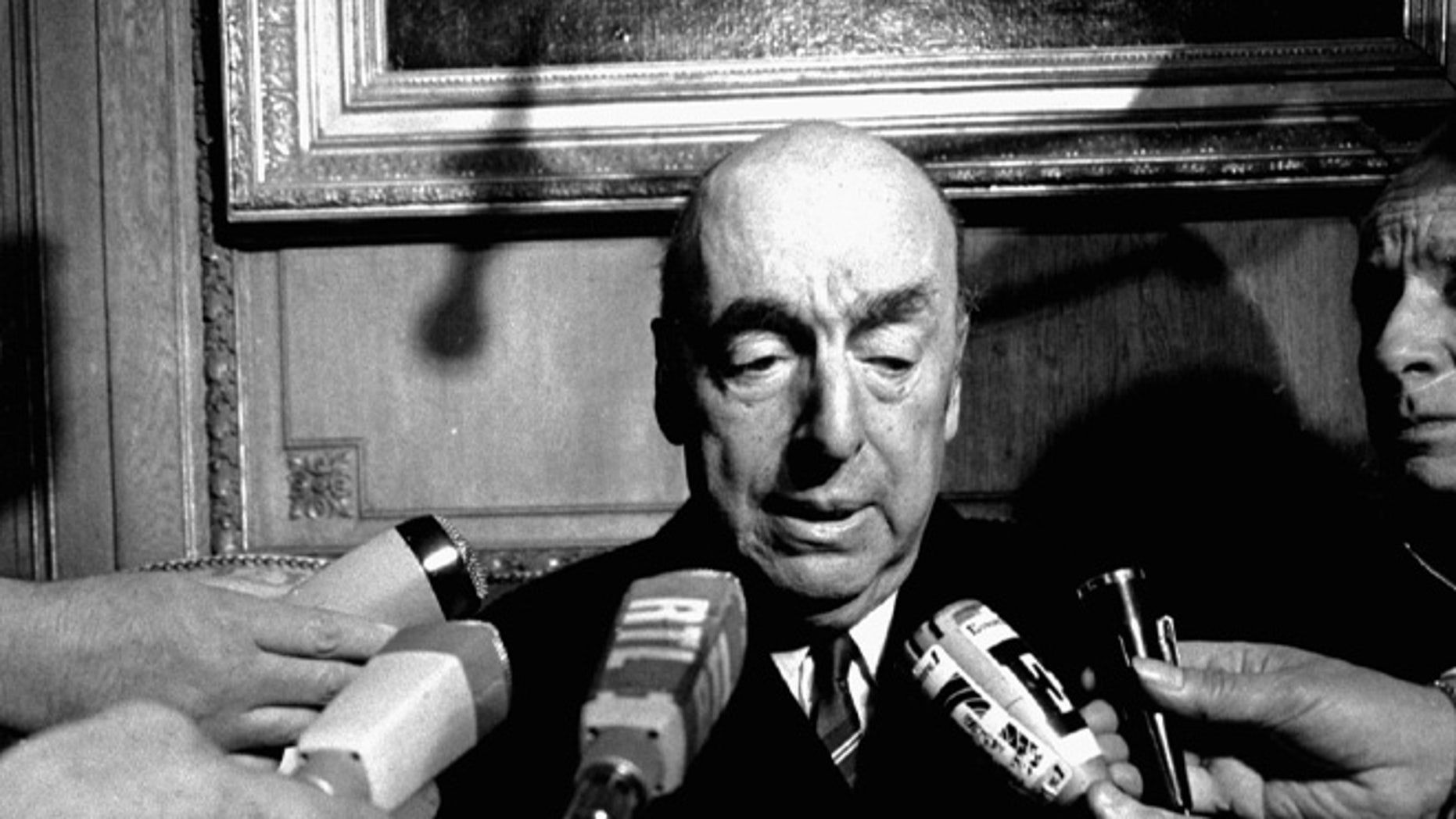 FILE - This Oct. 21, 1971 file photo shows Pablo Neruda, poet and then Chilean ambassador to France, talk with reporters in Paris after being named the 1971 Nobel Prize for Literature. Chileâs government is acknowledging that Neruda might have been killed after the 1973 coup that brought Gen. Augusto Pinochet to power. The Chile's Interior Ministry released a statement Thursday, Nov. 5, 2015, amid press reports that Neruda might not have died of cancer . (AP Photo/Laurent Rebours, File)
