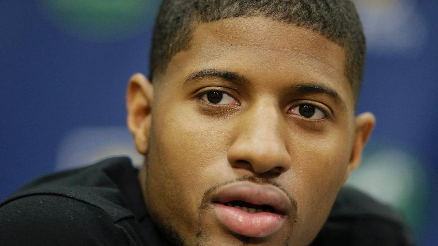 FILE - In this Aug. 15, 2014, file photo, Indiana Pacers' Paul George responds to a question during a news conference in Indianapolis. Paul George defended Ray Rice on Twitter, Thursday, Sept. 11, 2014, then backtracked less than an hour later by deleting the posts and apologizing to women and victims of domestic violence. (AP Photo/Darron Cummings, File)