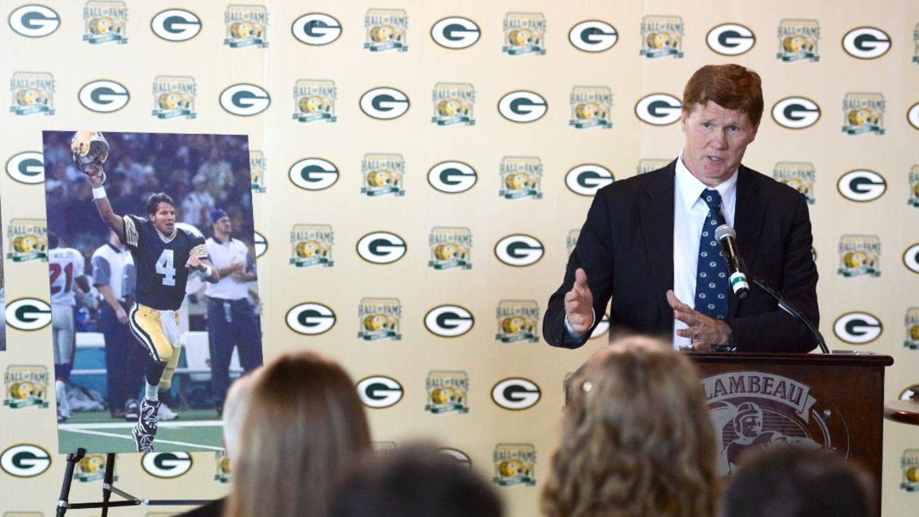 Green Bay Packers president/CEO Mark Murphy announces during a news conference at Lambeau Field, Monday, August 4, 2014, that former Packers quarterback Brett Favre's name and No. 4 will be unveiled inside Lambeau Field during a game in the fall of 2015.  (AP Photo/The Green Bay Press-Gazette, H. Marc Larason) NO SALES