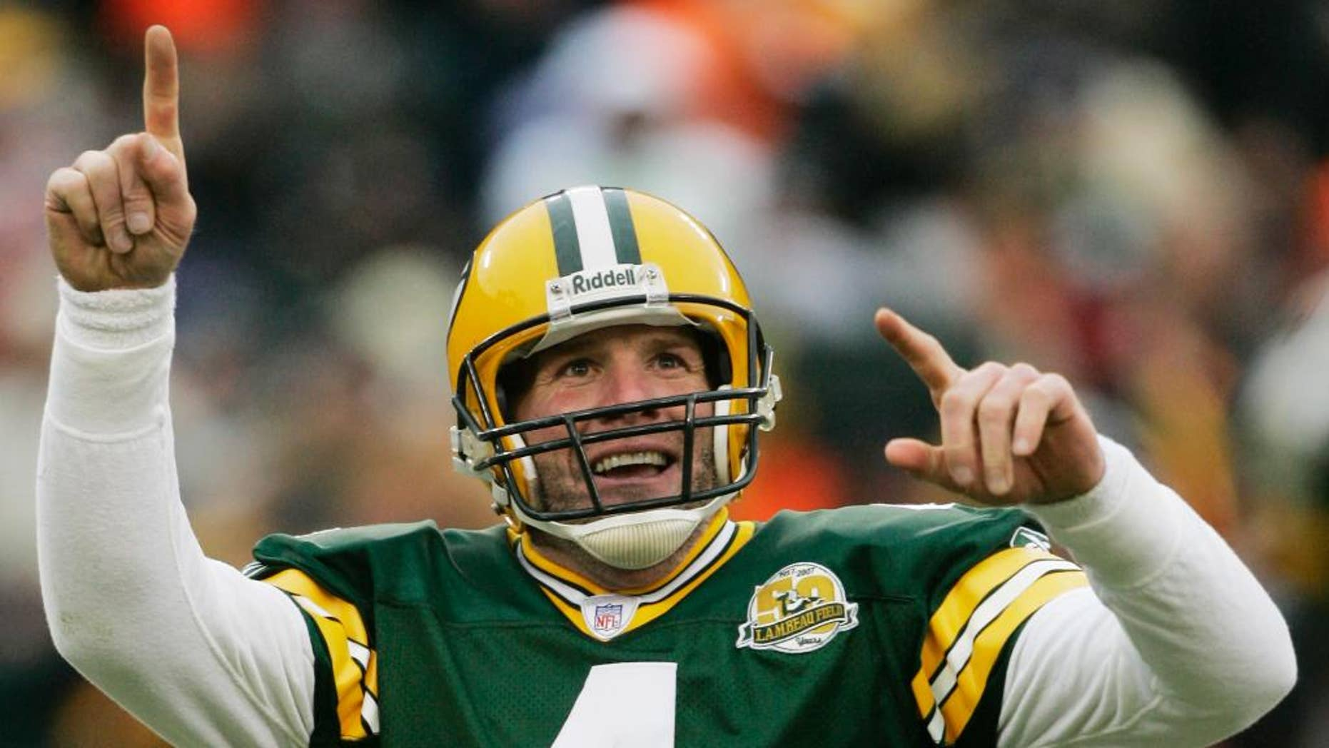 FILE - In this Dec. 9, 2007 file photo, Green Bay Packers quarterback Brett Favre reacts to a 46-yard touchdown pass to tight end Donald Lee during the second half of an NFL football game against the Oakland Raiders in Green Bay, Wis.  Favre will be inducted into the team's Hall of Fame and have his jersey retired next year. Favre writes on his official website that it will be an honor to have his name placed among others such Bart Starr, Curly Lambeau, Ray Nitschke and Vince Lombardi, to name a few.  (AP Photo/Morry Gash, File)
