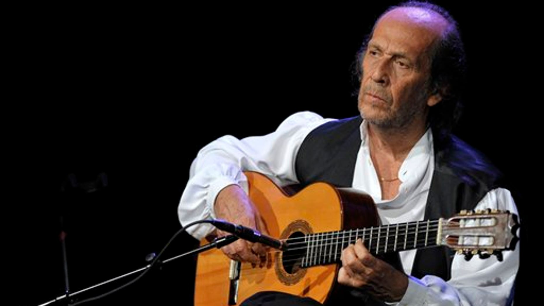 FILE - In this July 8, 2010 file photo, Spanish flamenco guitarist Paco de Lucia performs on the Miles Davis Hall stage at the 44th Montreux Jazz Festival, in Montreux, Switzerland. Spanish officials said Wednesday Feb. 26, 2014 that world-renowned flamenco guitarist Paco de Lucia has died. He was 66. Jose Ignacio Landaluce, mayor of de Lucia's native Spanish town of Algeciras said in a statement Wednesday the guitarist died in Mexico, where he lived.The cause of death was not immediately made known. De Lucia, whose real name was Francisco Sanchez Gomez, was recognized as one of the world's leading guitarists, dazzling audiences with his lightning-speed flamenco rhythms and finger work. (AP Photo/Keystone, Martial Trezzini, File)