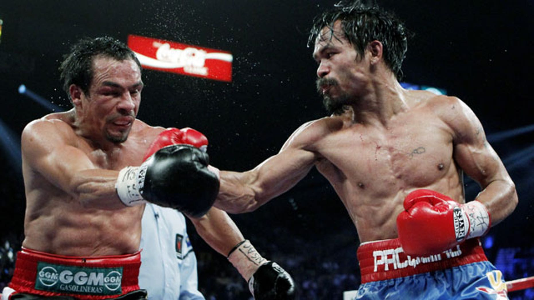 November 12, 2011: Manny Pacquiao, right, of the Philippines, hits Mexico's Juan Manuel Marquez during a WBO welterweight title fight in Las Vegas.