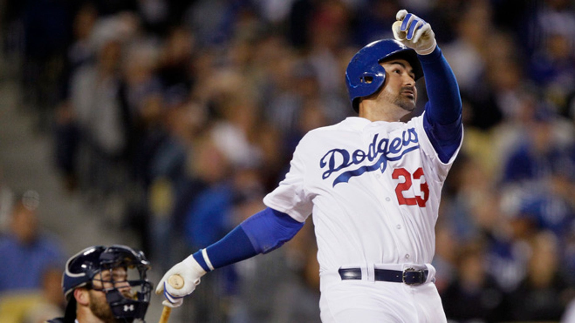 Los Angeles Dodgers' Adrian Gonzalez watches his solo home run in front of San Diego Padres catcher Derek Norris during the fifth inning of a baseball game in Los Angeles, Wednesday, April 8, 2015. It was Gonzalez's third homer of the night. (AP Photo/Alex Gallardo)