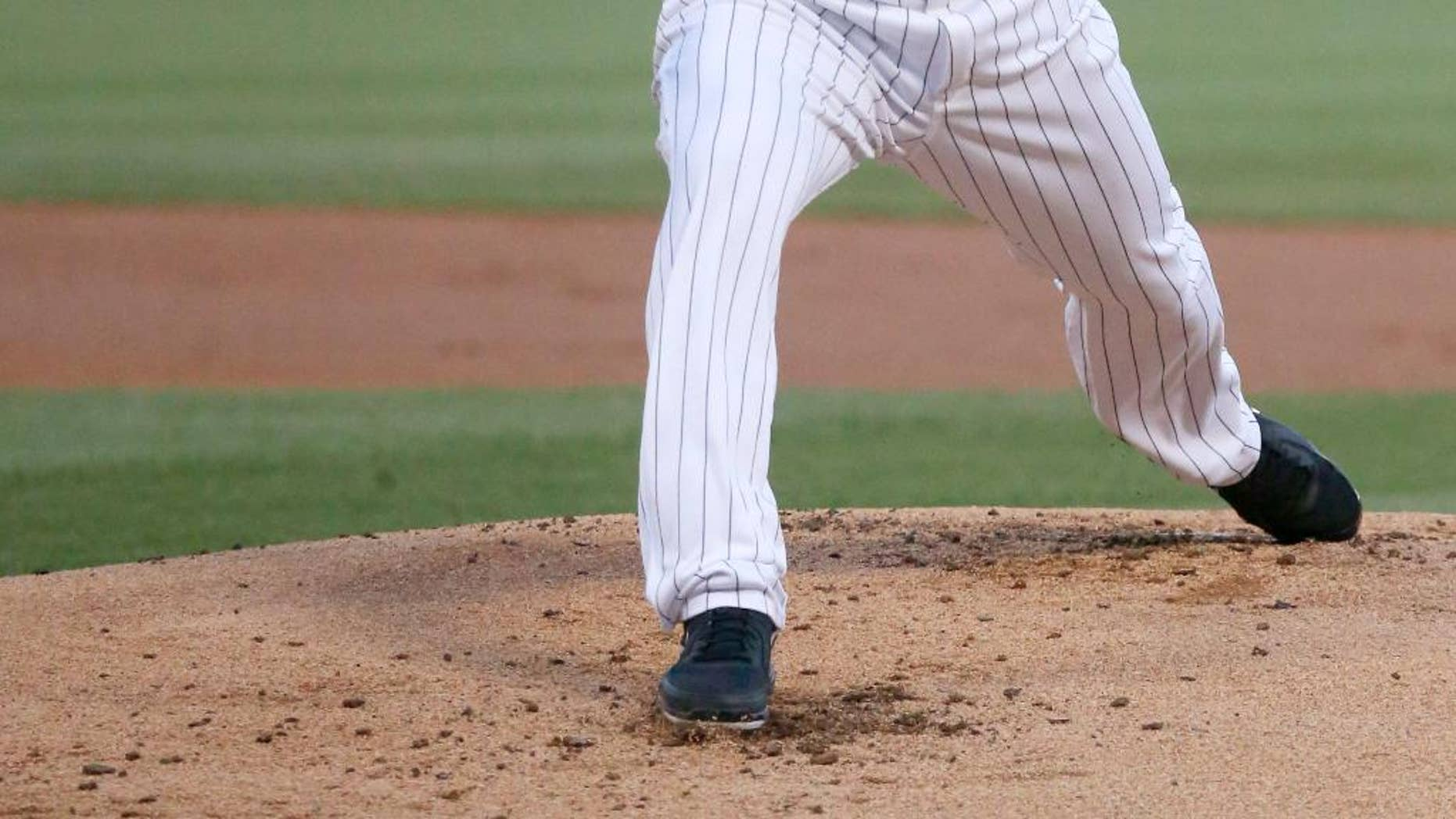 Chicago White Sox starting pitcher John Danks delivers during the first inning of an interleague baseball game against the San Diego Padres on Friday, May 30, 2014, in Chicago. (AP Photo/Charles Rex Arbogast)