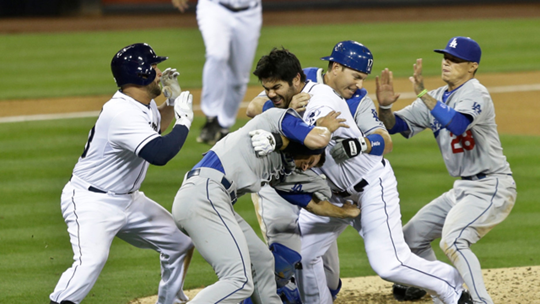 April 11, 2013: San Diego Padres' Carlos Quentin, center, and teammates battle the Los Angeles Dodgers after Quentin was hit by a pitch thrown by Angeles Dodgers pitcher Zack Greinke in the sixth inning of baseball game in San Diego.
