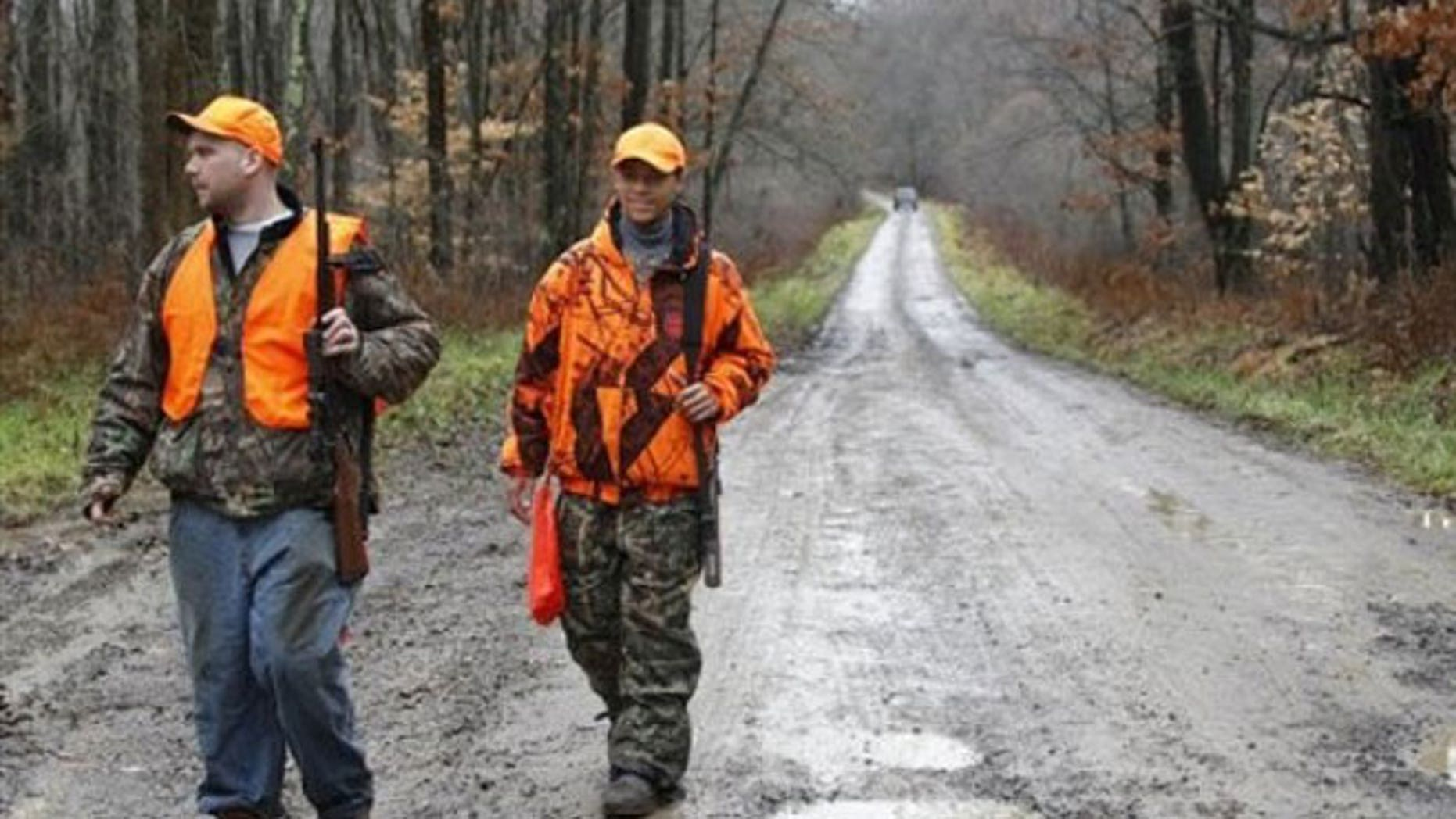 November 28, 2011: Deer hunters hike down a gravel road in Moraine State Park on the first day of Pennsylvania's white-tailed deer rifle hunting season in West Liberty, Pa.
