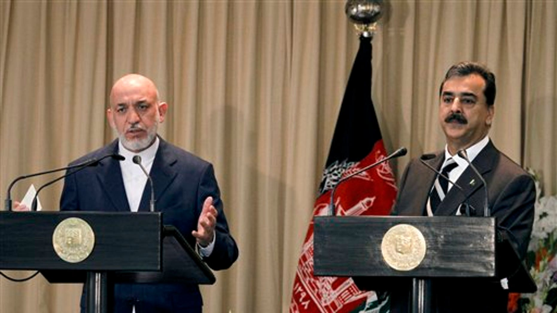 Afghan President Hamid Karzai, left, speaks, with Pakistani Prime Minister Yousuf Raza Gilani on the right, during a joint press conference in Islamabad, Pakistan.