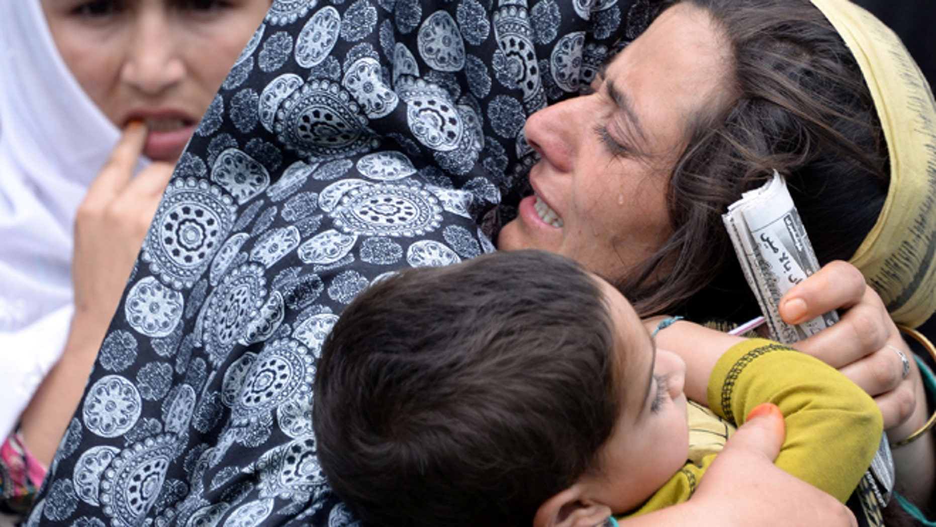 Aug. 5, 2015: Family members of Shafqat Hussain, who was convicted and hanged for killing a boy, mourn his death in Pakistani Kashmir.