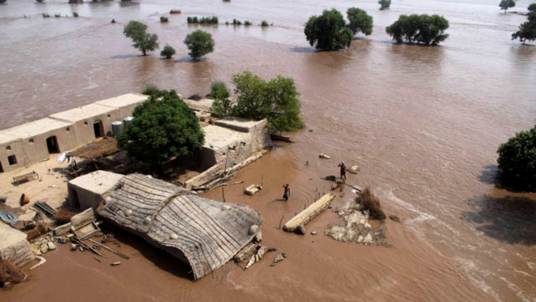 September 12, 2014: Pakistani villagers wait to be rescued as  they are stranded by flood waters in district Multan, Pakistan. (AP Photo/Mansoor Abass)
