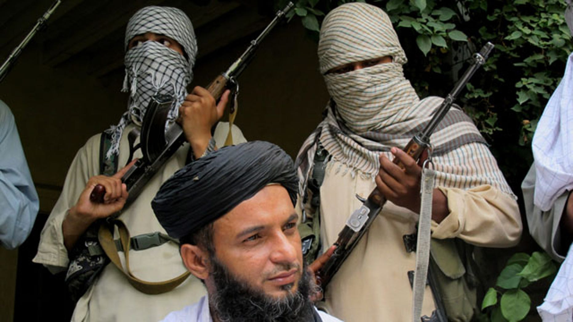 August 15, 2013: Asmatullah Muawiya, head of Tehrik-i-Taliban Pakistan Punjab, talks to media at an undisclosed place in Pakistani tribal region of Waziristan. Militants in Pakistan's most populous province are said to be training for what they expect will be an ethnic-based civil war in neighboring Afghanistan after foreign forces withdraw. (AP Photo)