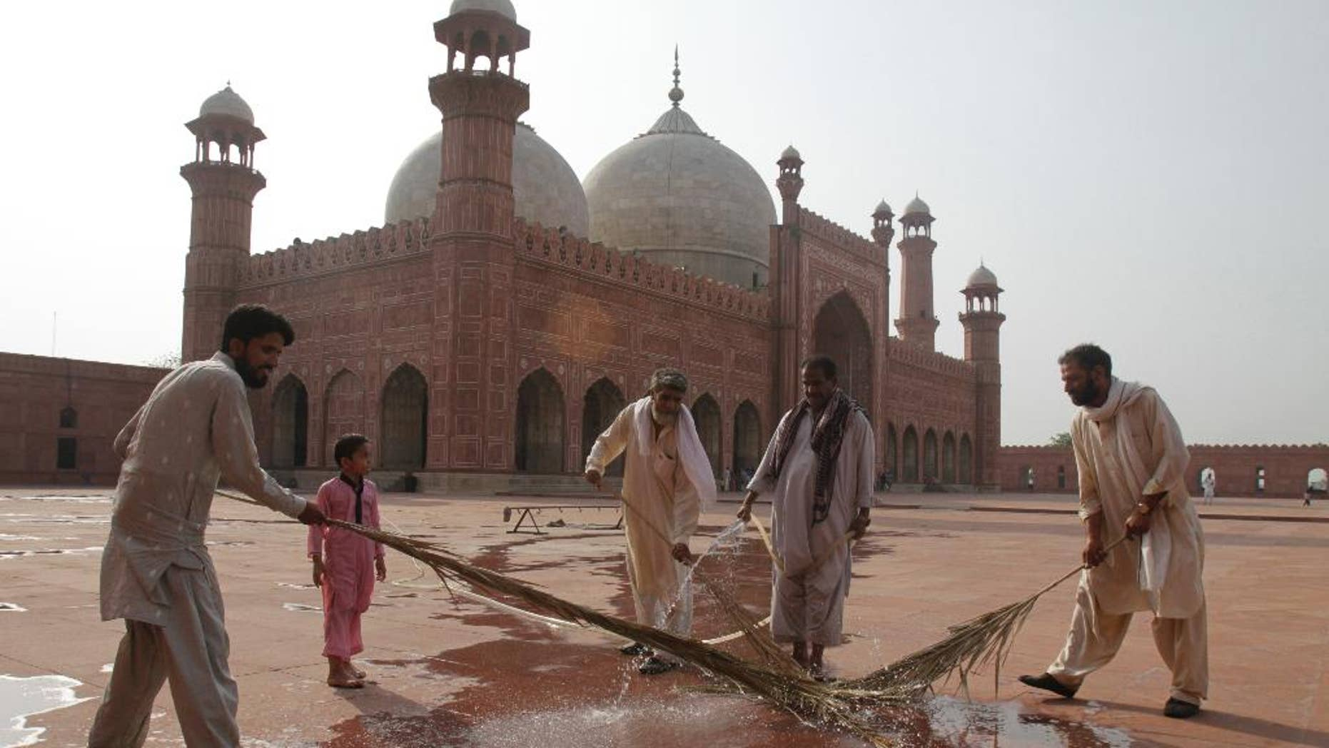 Preparations are in progress for the upcoming Ramadan at the 17th century Badshahi mosque in Lahore, Pakistan, Wednesday, June 17, 2015. Muslims throughout the world mark the month of Ramadan, the holiest month in the Islamic calendar, with dawn to dusk fasting. (AP Photo/K.M. Chaudary)