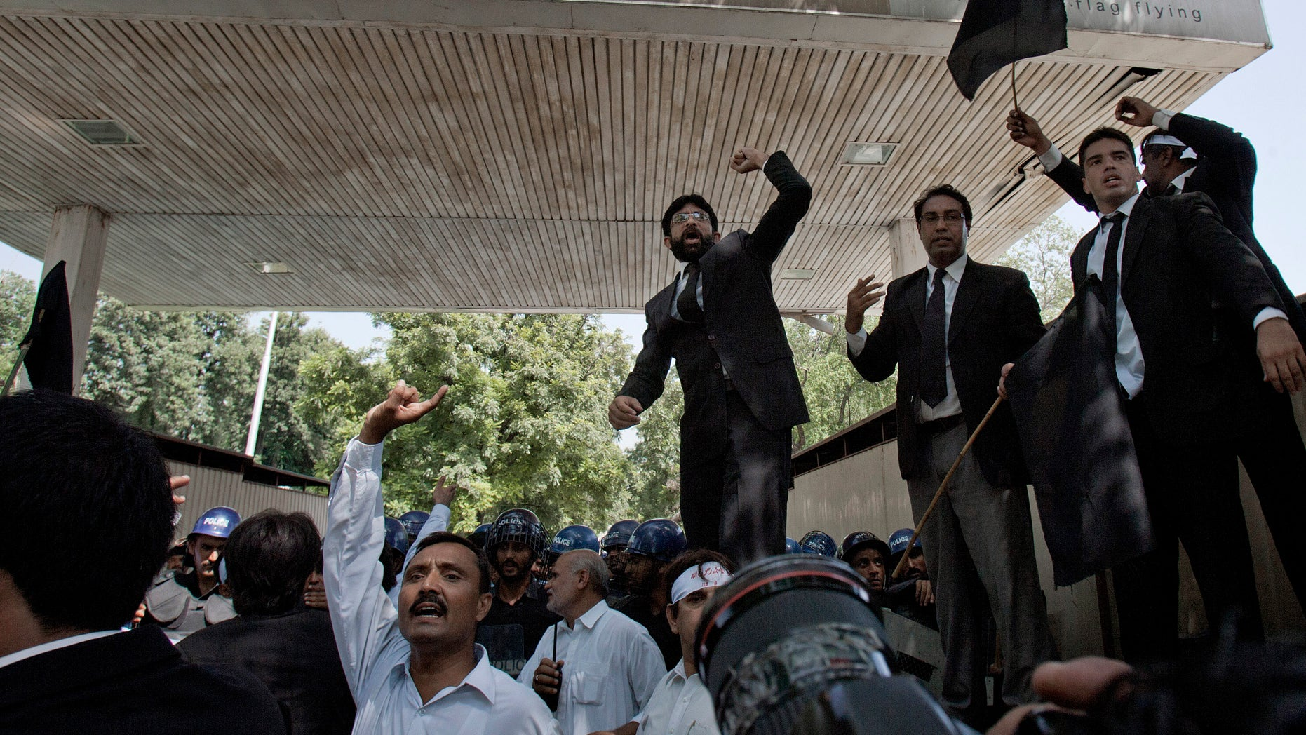Pakistani lawyers chant anti-U.S. slogans during a demonstration, near an area that houses the U.S. Embassy and other foreign missions in Islamabad, Pakistan on Wednesday, Sept. 19, 2012. The demonstration in Islamabad followed three days of violent protests against an anti Islam film in Pakistan in which two people were killed. Over two dozen more have been killed in protests in other parts of the Muslim world over the past week, including the U.S. ambassador in Libya. (AP Photo/Anjum Naveed)