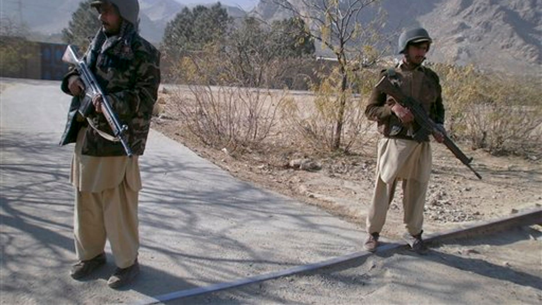 Dec. 18, 2010: Pakistani paramilitary soldiers stand guard at a checkpoint in Sadukheil village near Landi Kotel, in Pakistan's Khyber tribal region along the Afghan border.