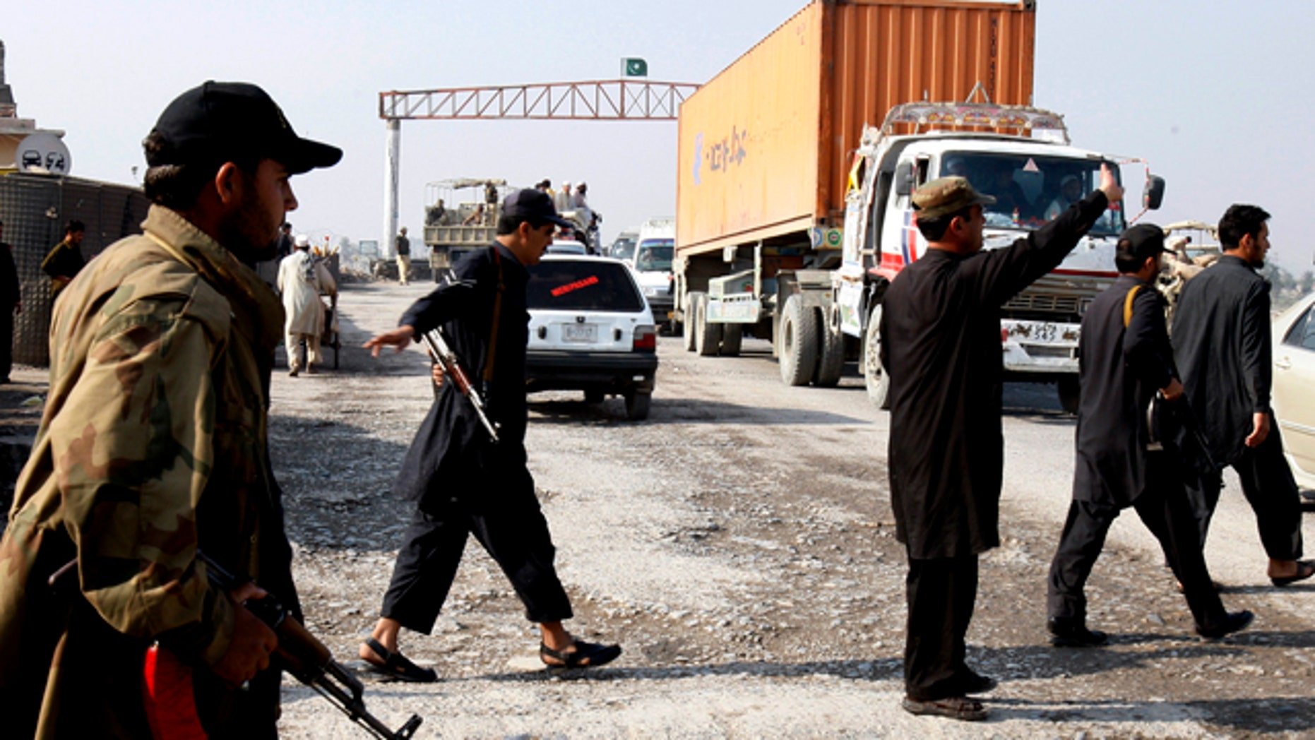 Nov. 26: Pakistani security personnel stop trucks carrying supplies for NATO forces in neighboring Afghanistan at Takhtabeg check post in Pakistan.