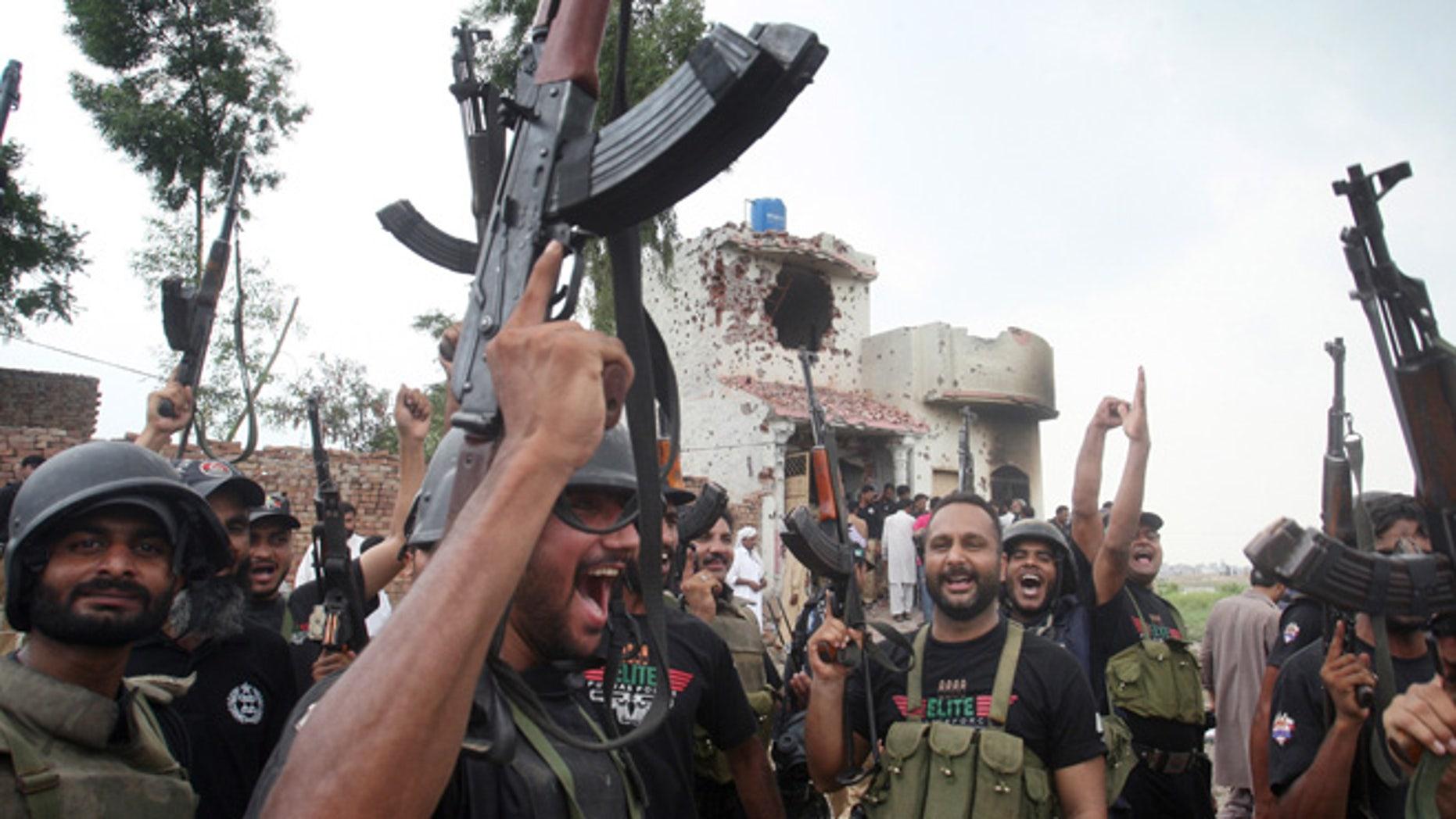 July 17, 2014: Pakistani police commandos celebrate a successful operation against terrorists in Lahore, Pakistan. (AP)