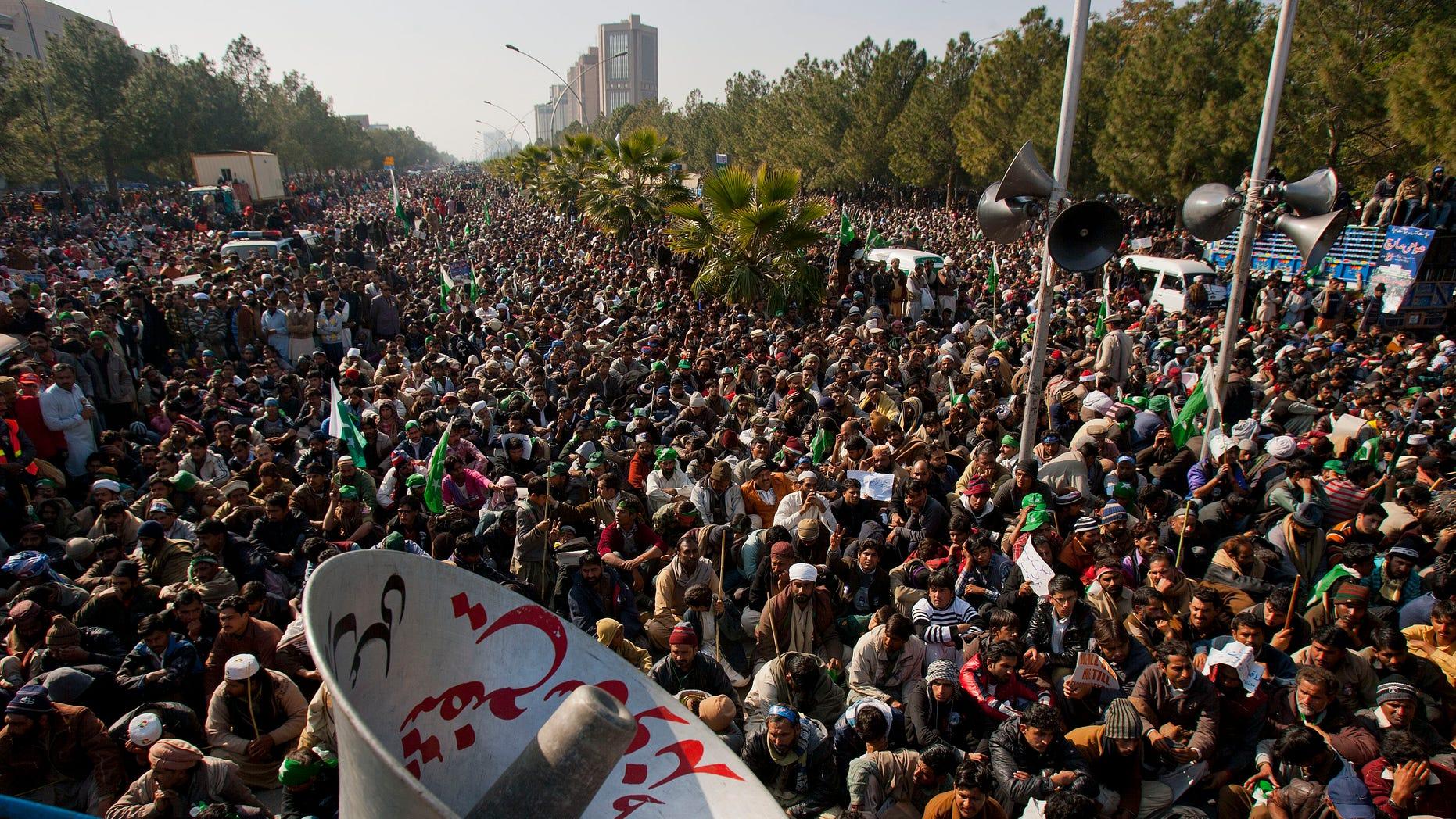 Jan. 15, 2013: Supporters of Pakistani Sunni Muslim cleric Tahir-ul-Qadri listen to a speech by ul-Qadri, unshown, at an anti-government rally in Islamabad, Pakistan.