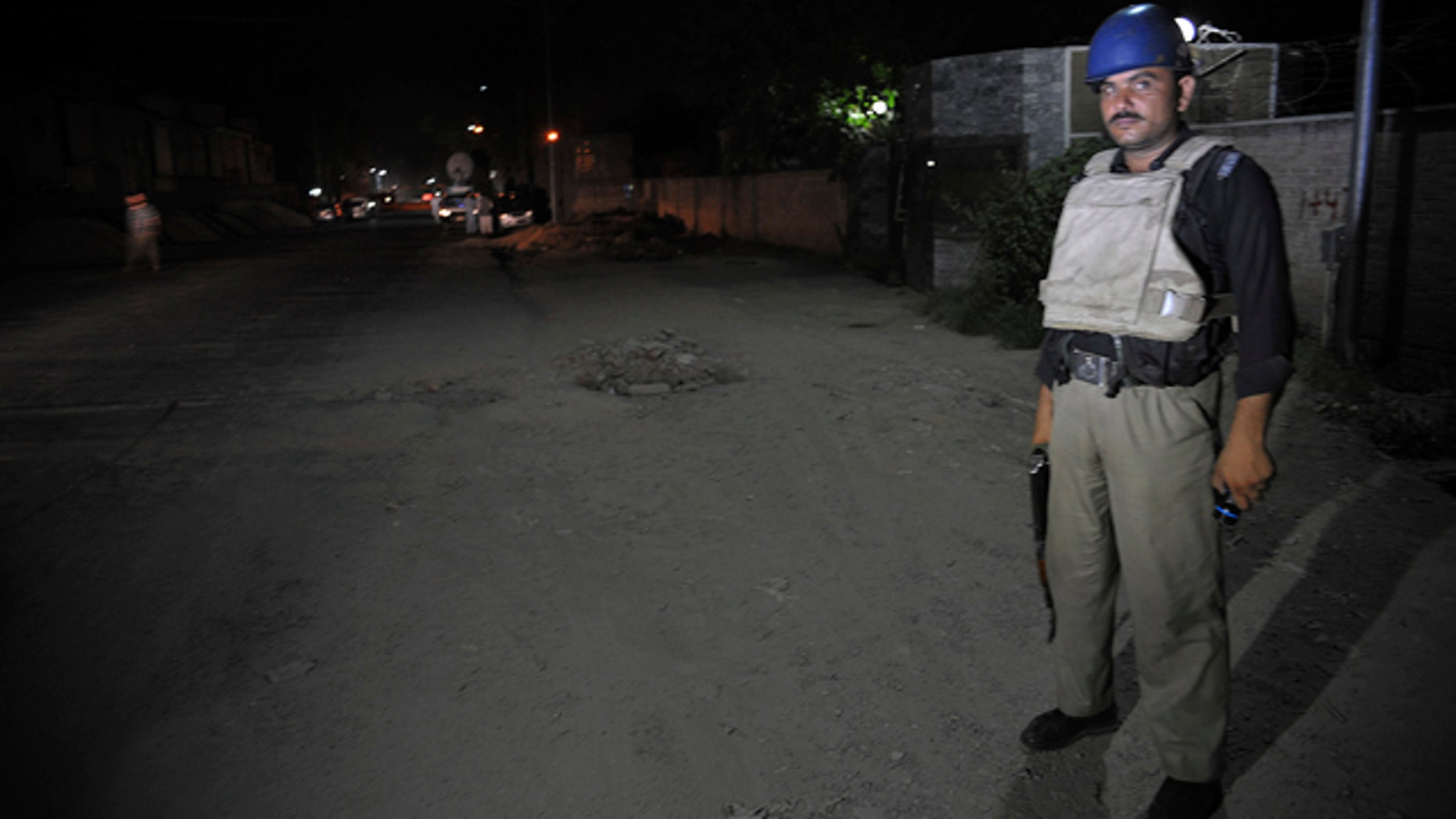 June 25, 2014: A Pakistani police officer stands guard near Peshawar airport which is cordon off, Wednesday, June 25, 2014 in Pakistan. (AP Photo/Mohammad Sajjad)