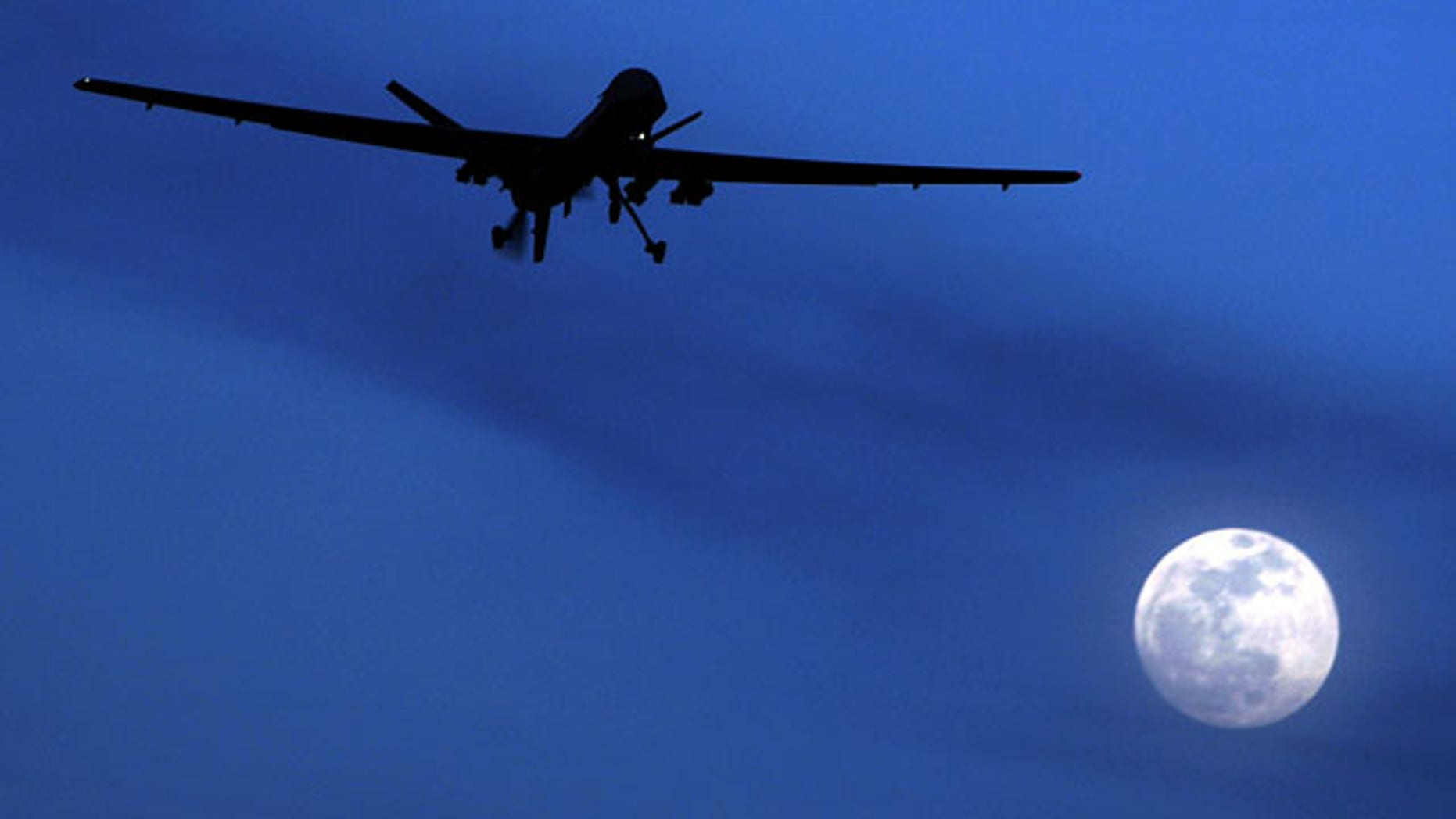 FILE - In this Jan. 31, 2010 file photo, an unmanned U.S. Predator drone flies over Kandahar Air Field, southern Afghanistan, on a moon-lit night. The Pakistani government said Wednesday, Oct. 30, 2013, that 3 percent of the people killed in U.S. drone strikes in the country since 2008 were civilians, a surprisingly low figure given past official calculations and estimates from independent organizations. (AP Photo/Kirsty Wigglesworth, File)