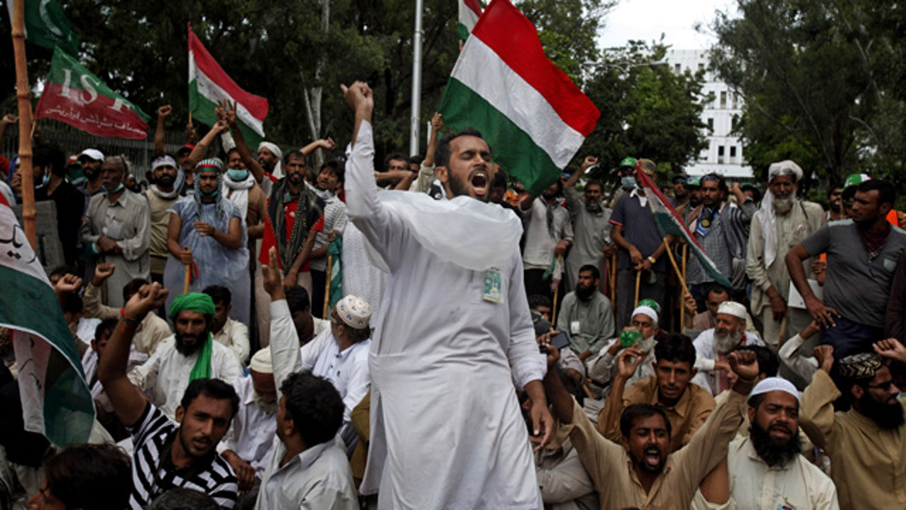 September 1, 2014: Supporters of anti-government Muslim cleric Tahir-ul-Qadri chant slogans during a protest close to the Prime Minister's home in Islamabad, Pakistan. (AP Photo/Anjum Naveed)