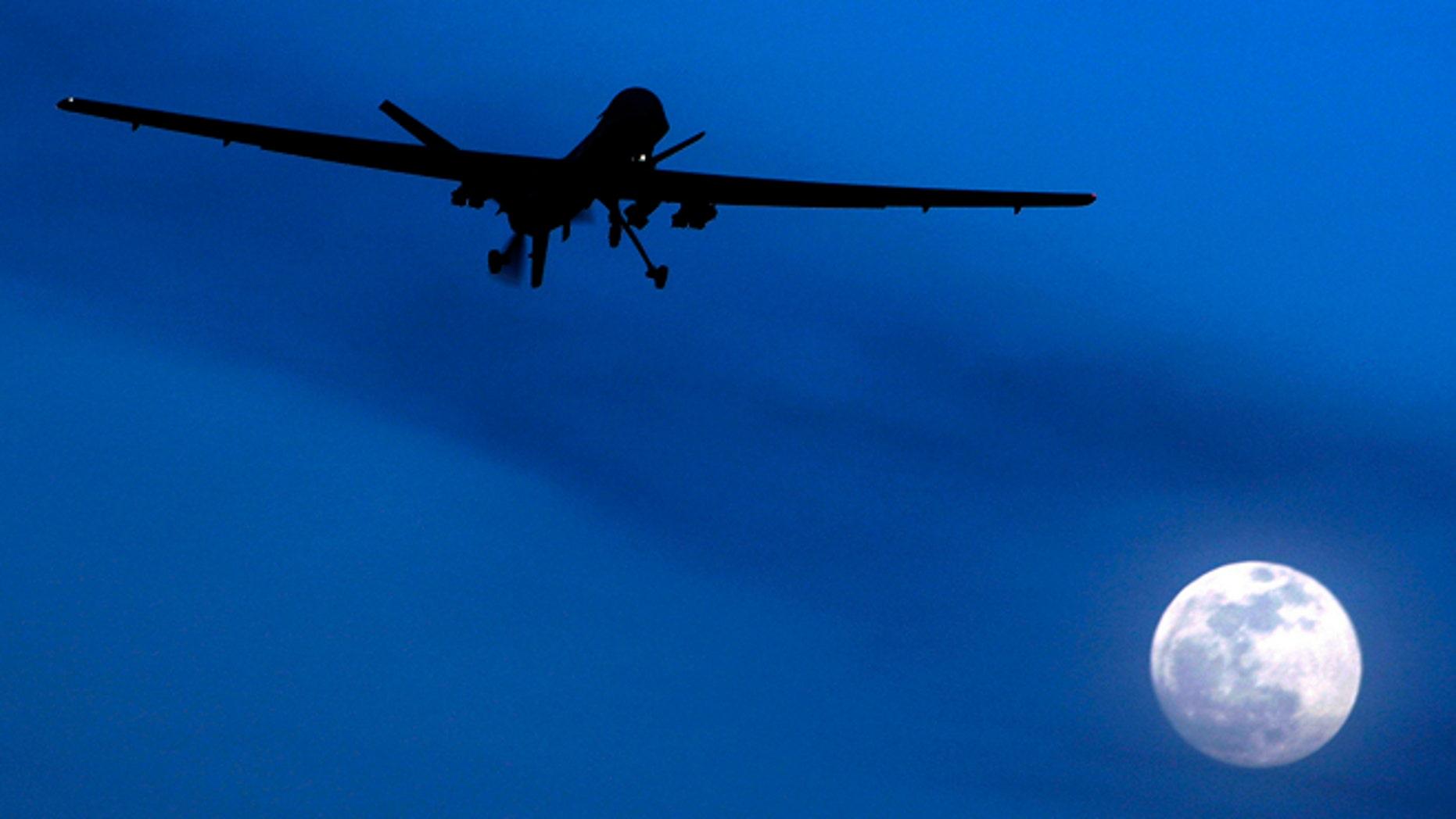 FILE 2010: Unmanned U.S. Predator drone flies over Kandahar Air Field, southern Afghanistan.