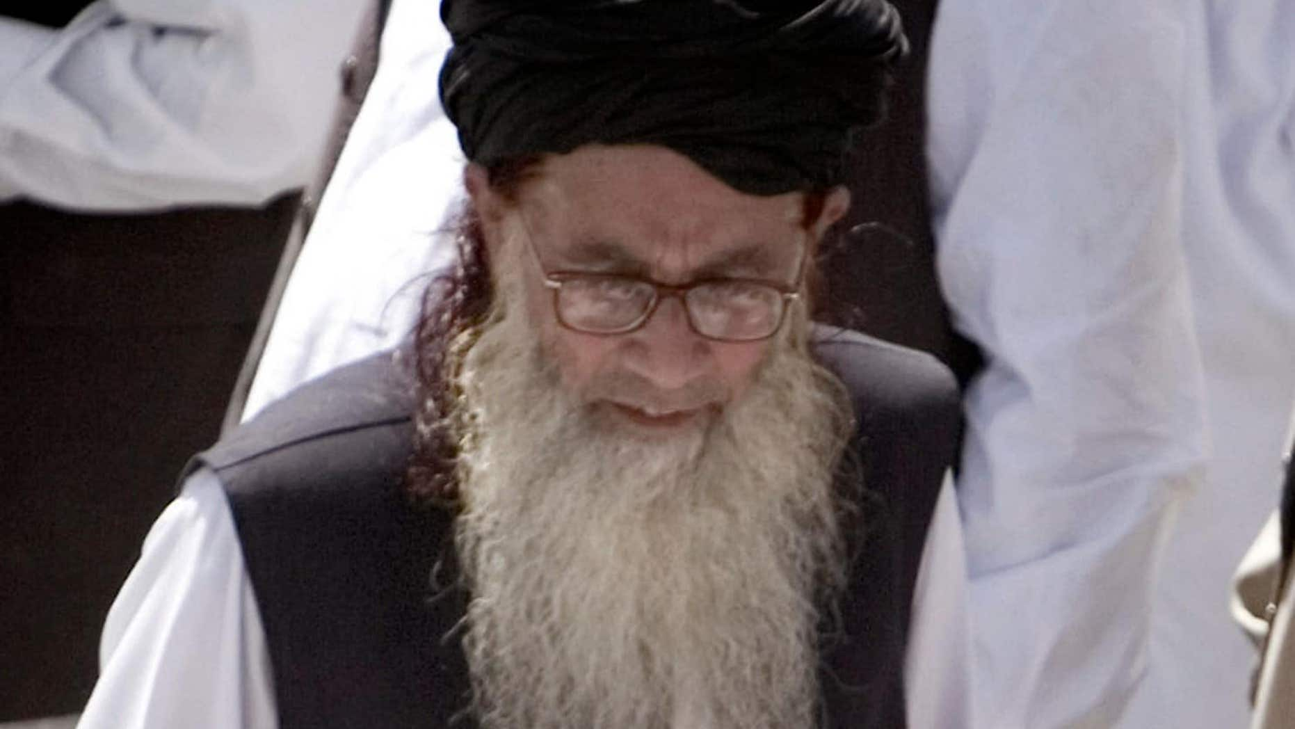 FILE 2009:  Pakistan's hard line cleric Sufi Muhammad arrives to address his supporters in Mingora, Pakistan.