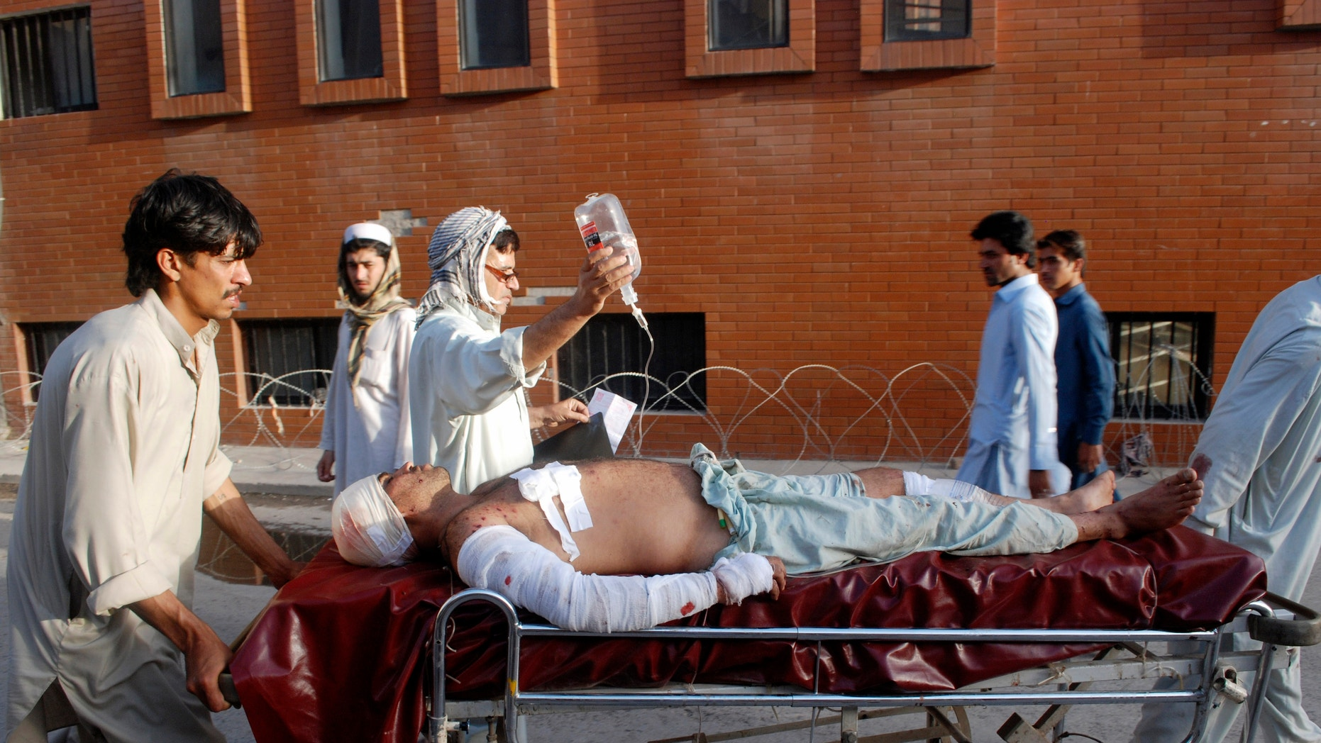 May 17, 2013 - A Pakistani man injured in a bomb blast in a mosque in the Malakand district of Khyber Pakhtunkhwa province, is brought to a hospital in Peshawar, Pakistan.