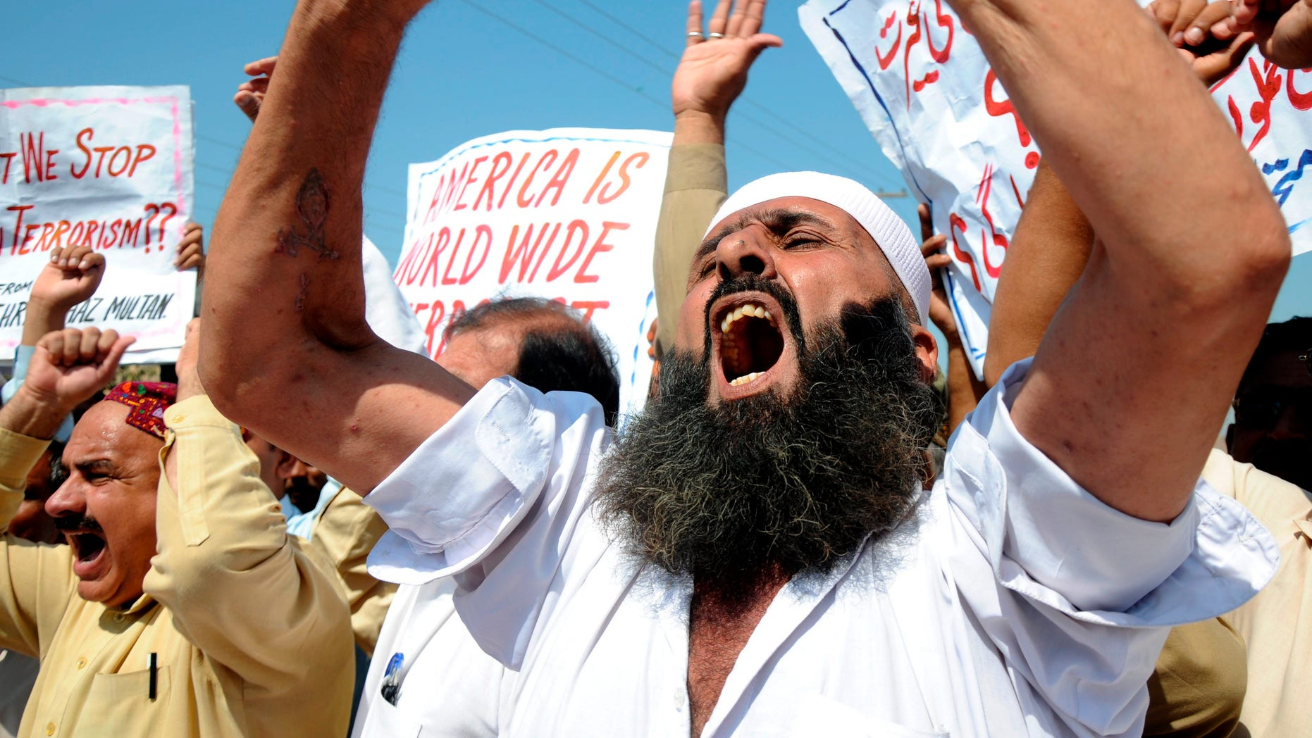 People shout anti-American slogans at a rally to condemn U. S. strikes on militants' hideouts in Pakistani tribal areas, in Multan, Pakistan on Friday, Oct 14, 2011.