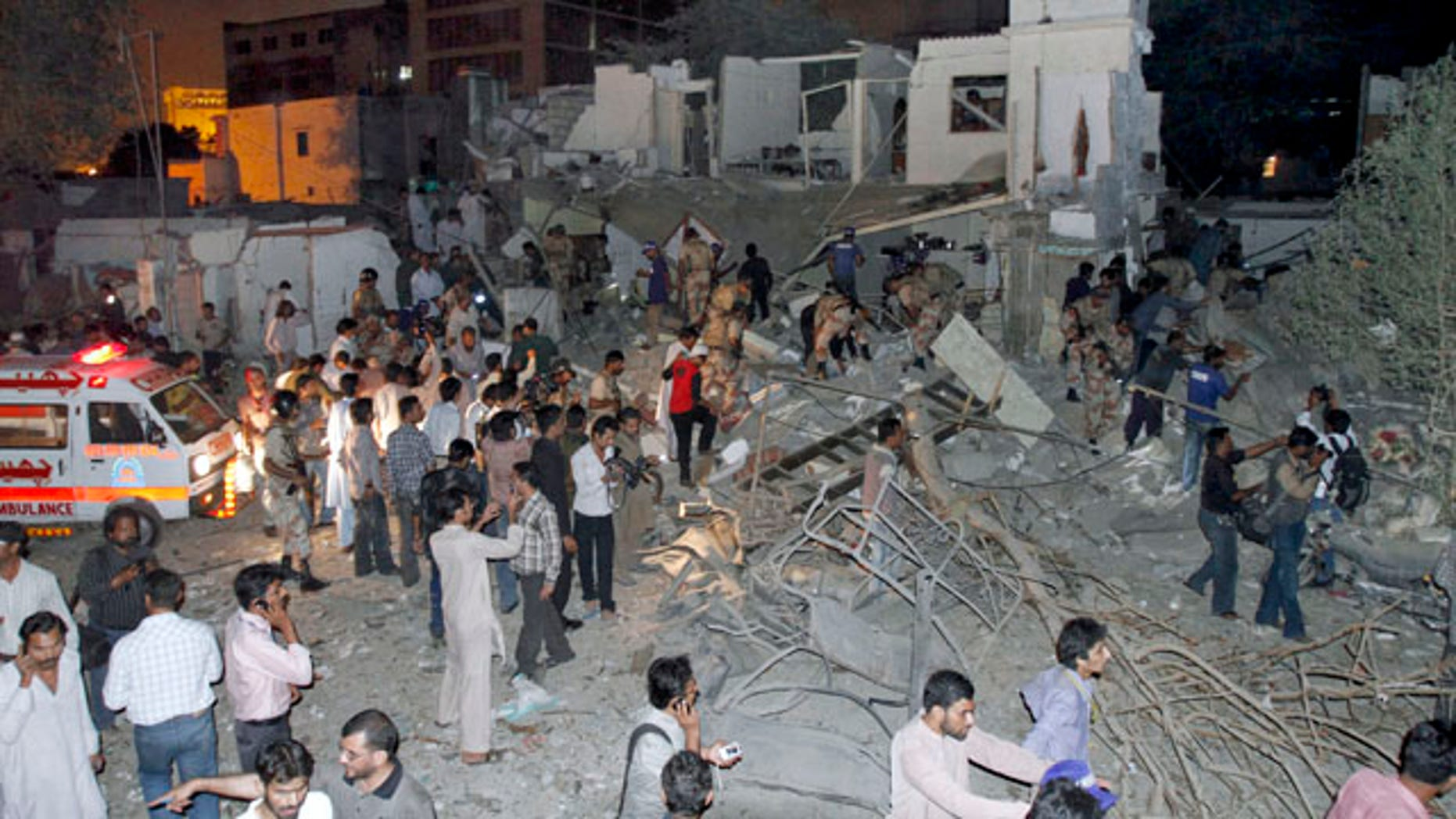 Nov. 11: Pakistani security officials and media gather at the site of a bomb explosion in Karachi, Pakistan.