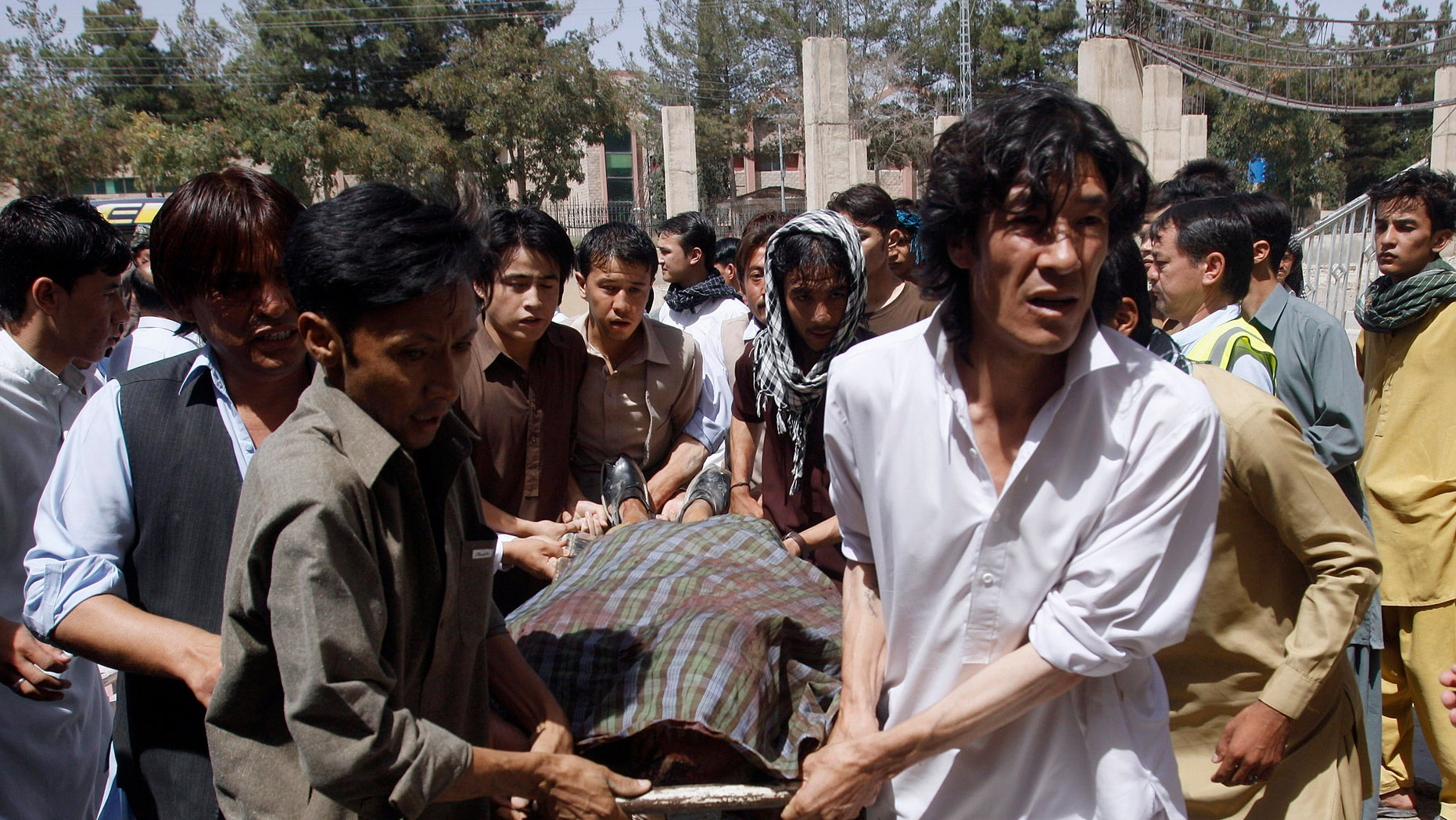 Pakistani Shiite Muslims carry the body of a person killed by gunmen at a local hospital in Quetta, Pakistan on Saturday, Sept. 1, 2012. A group of gunmen on motorcycles in the southwestern province of Baluchistan killed several Shiite Muslims, as violence against the minority sect continues to escalate. (AP Photo/Arshad Butt)
