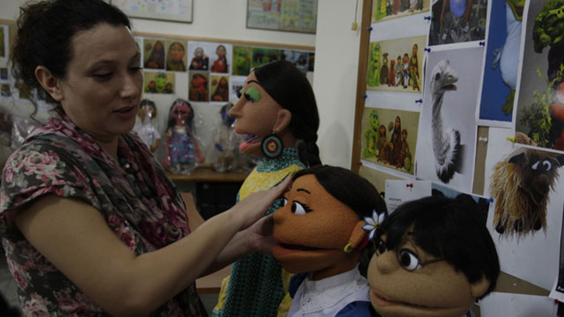 October 13, 2011: A Pakistani artist gives final touches to characters of Pakistani Sesame Street in Lahore, Pakistan.