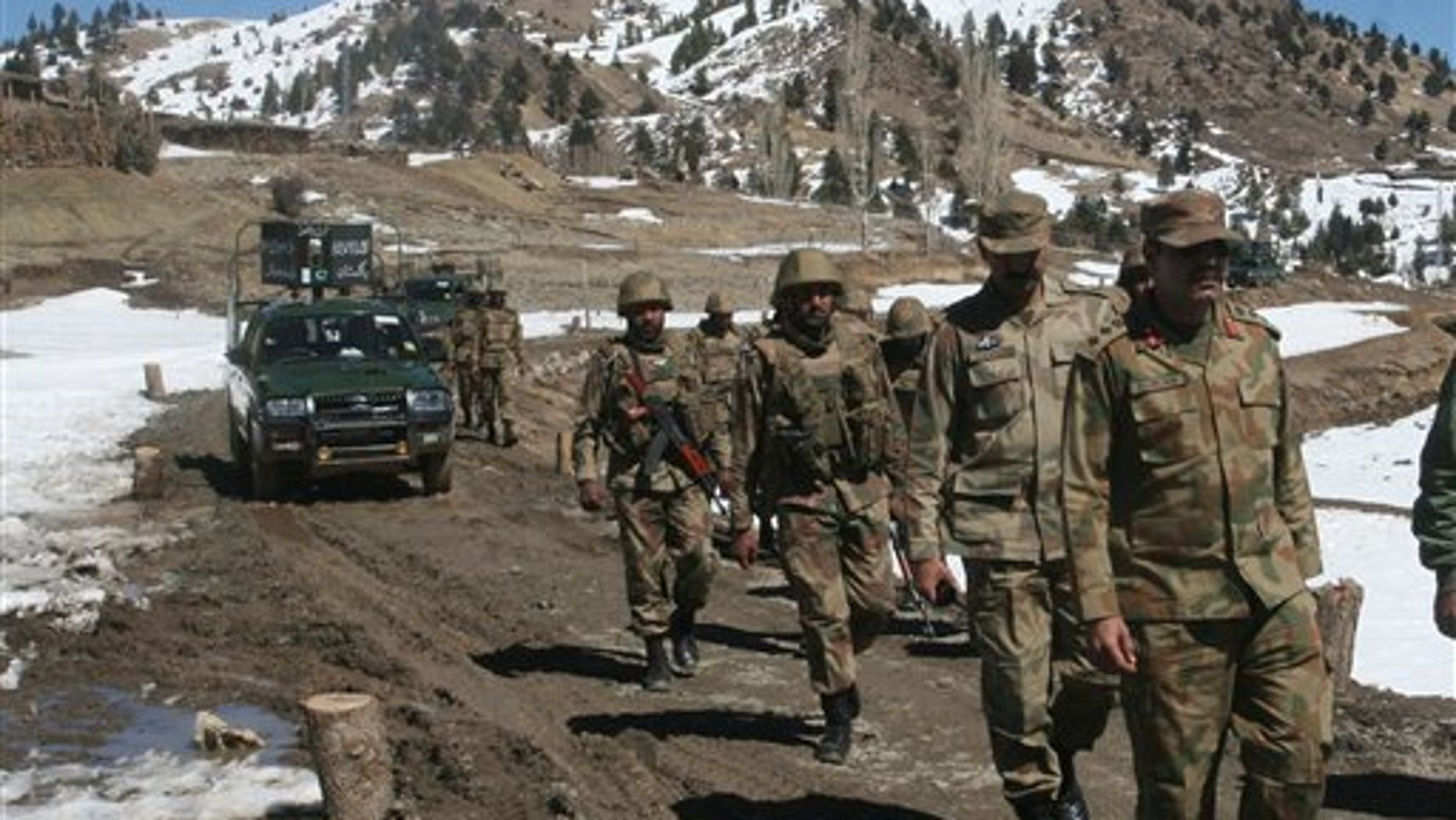 March 2011: Pakistan army soldiers patrol in the Pakistani tribal area of Ditta Kheil in North Waziristan where the Pakistan army are fighting against militants and al-Qaida activists along the Afghanistan border.