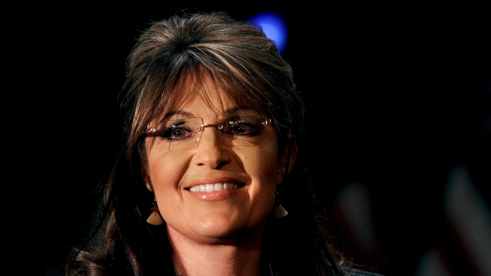 Feb. 17: Former Alaska Gov. Sarah Palin smiles as she is introduced during a public appearance at a Long Island Association (LIA) meeting and luncheon in Woodbury, N.Y. Palin says she is still thinking about running for president in 2012, but has not made up her mind.