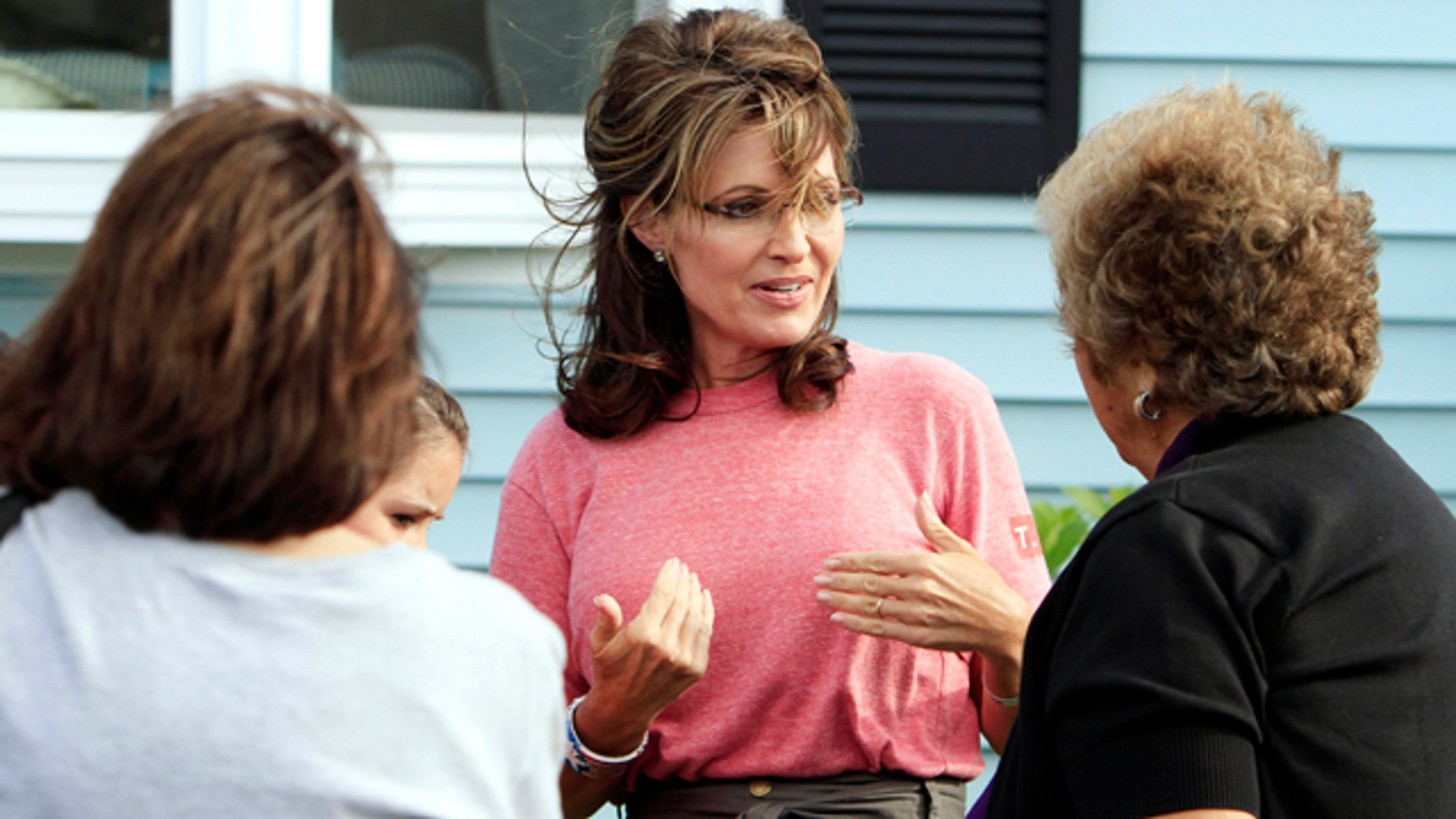 Thursday: Former Alaska governor and vice presidential candidate Sarah Palin talks with guests at a house party in Seabrook, N.H.