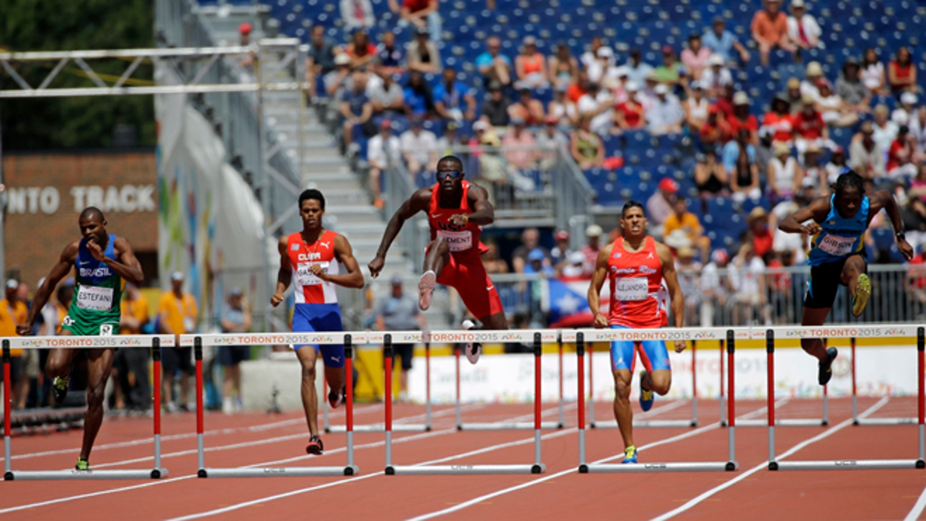 USA's Kerron Clement jumps over a hurdle and wins during a men's 400m hurdles semifinal race at the Pan Am Games in Toronto, Wednesday, July 22, 2015. (AP Photo/Mark Humphrey)