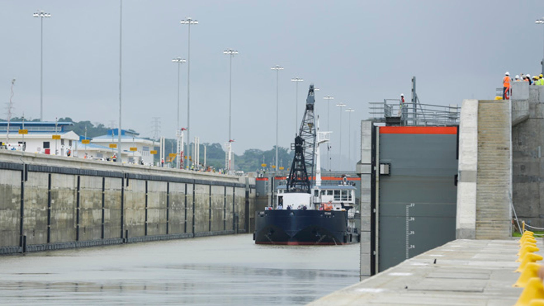 A Panama Canal Authority crane ship Oceanus, navigates the Cocoli locks during a test of the newly expanded Panama Canal locks on Pacific side, in Cocoli, Panama, Monday, June 20, 2016. The canal's expansion project will be officially inaugurated on June 26. (AP Photo/Arnulfo Franco)
