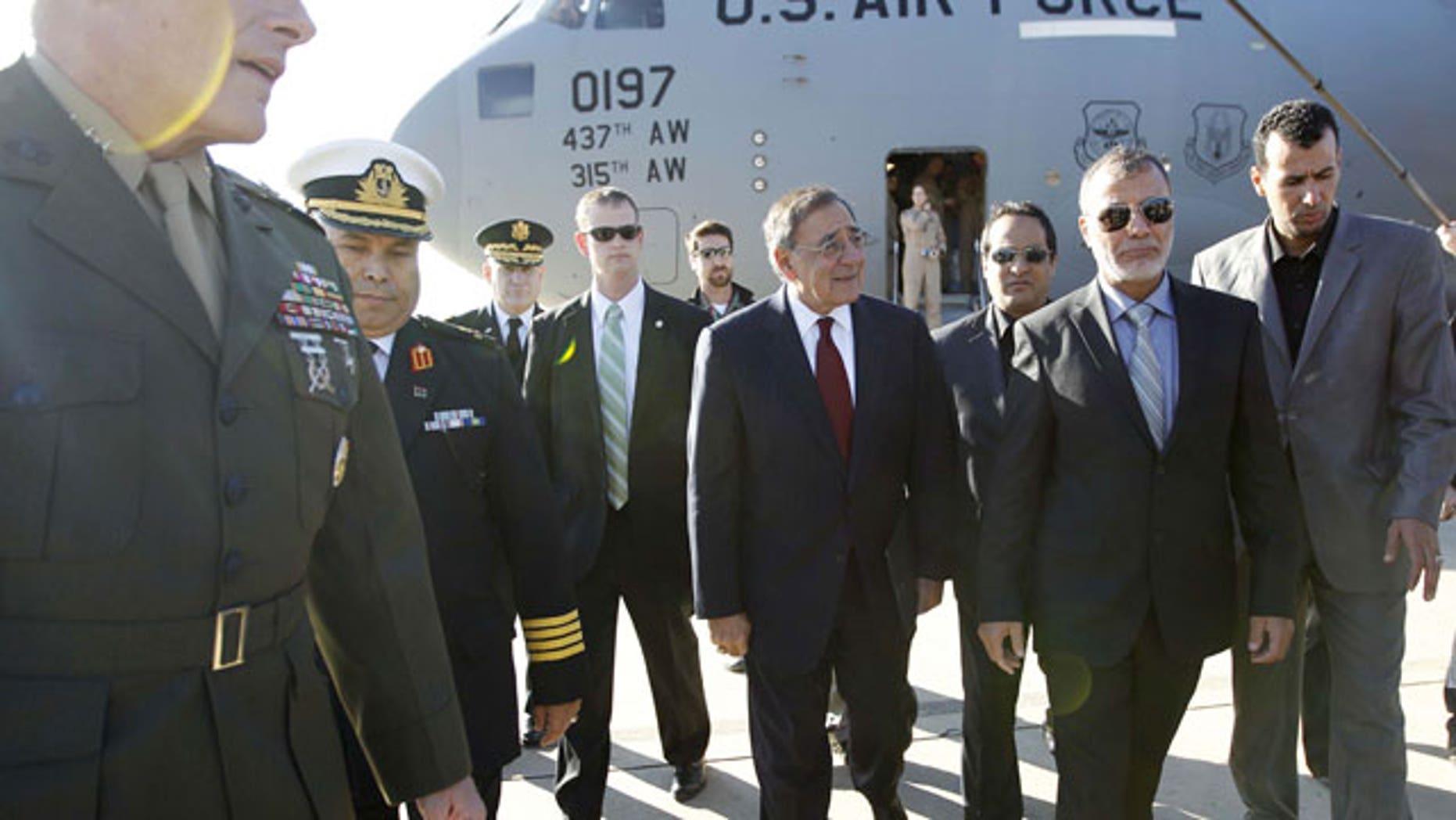 December 17, 2011: U.S. Sec. of Defense Leon Panetta walks across the tarmac during his arrival in Tripoli, Libya.