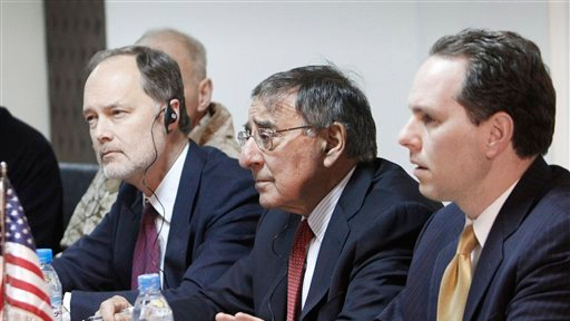 Mar. 14, 2012: U.S. Secretary of Defense Leon Panetta, center, listens to his Afghan counterpart Bismillah Mohammadi, unseen, during a  meeting at the interior ministry in Kabul, Afghanistan.