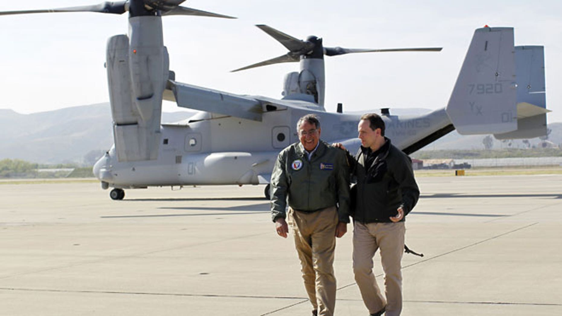 In this March 30, 2012 file photo, U.S. Secretary of Defense Leon Panetta, left, talks with his chief of staff Jeremy Bash after landing in an V-22 Osprey at Camp Pendleton, Calif. Recent crashes involving the U.S. military's latest transport aircraft are fueling  an uproar in Japan that could threaten plans to deploy them to the southern island of Okinawa by the end of the year.