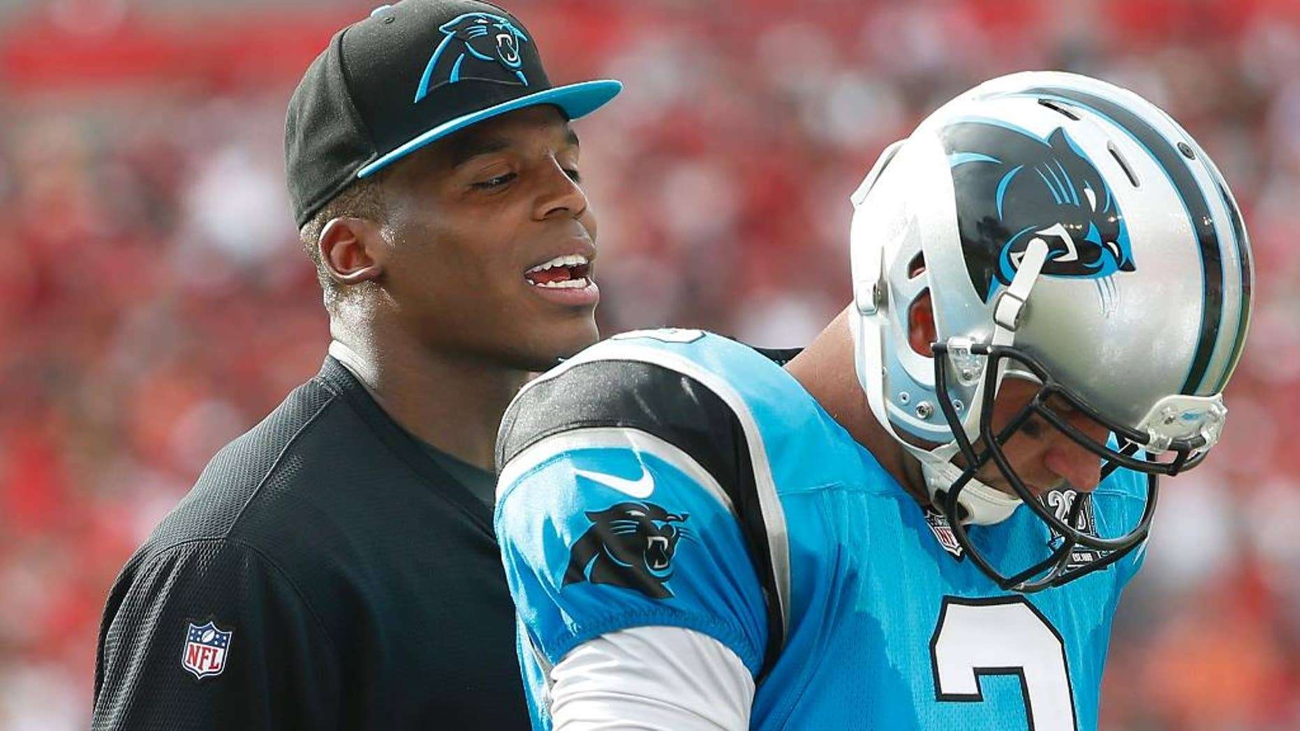 FILE - In this Sept. 7, 2014, file photo, Carolina Panthers quarterback Cam Newton, left, talks to quarterback Derek Anderson (3) during the second quarter of an NFL football in Tampa, Fla. Anderson proved he's a solid backup quarterback to have, throwing two TDs in Carolina's win against Tampa Bay. Now the question is if Anderson heads back to the bench or will start next Sunday's home opener against Detroit. (AP Photo/Brian Blanco, File)