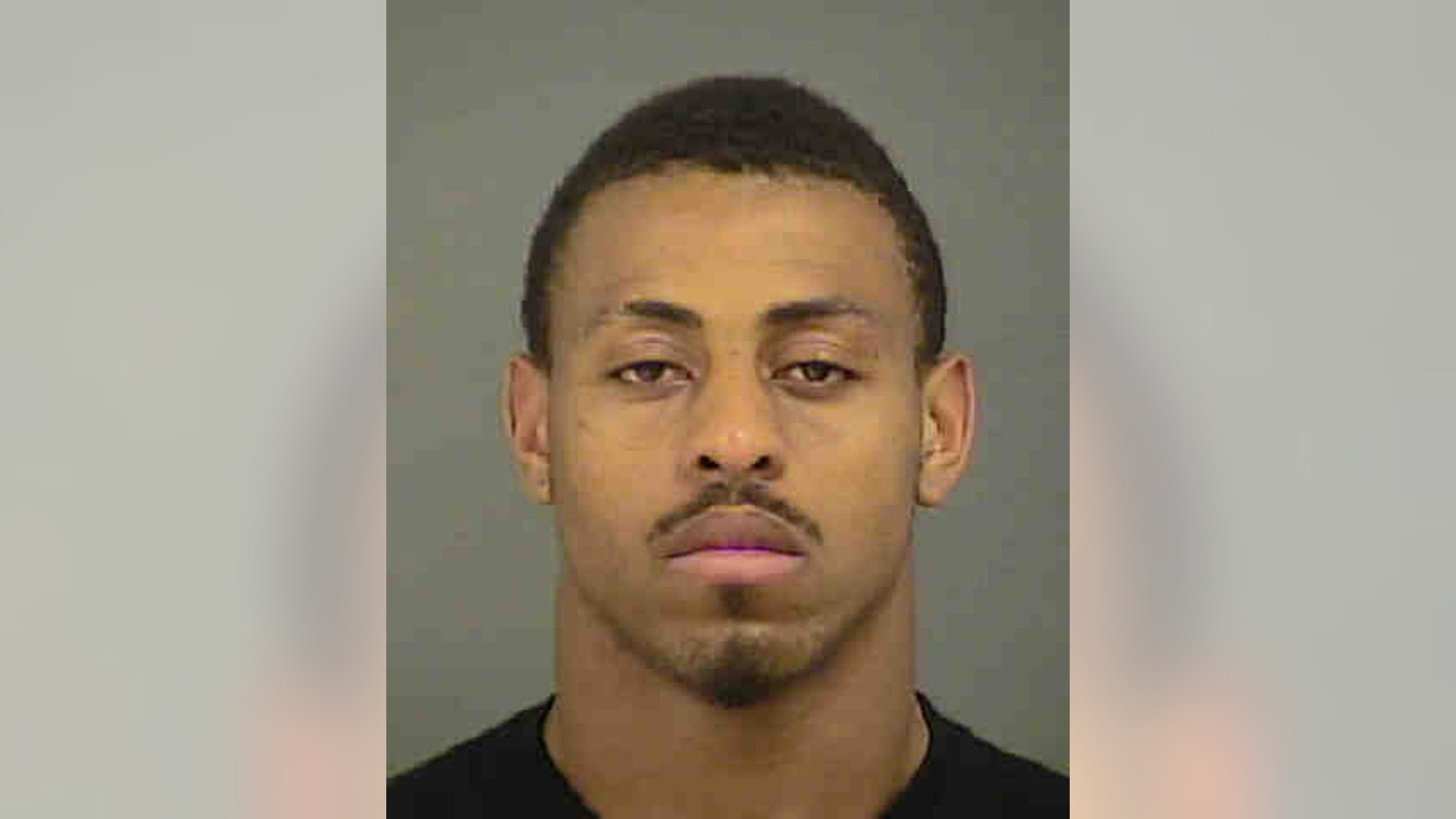 This photo provided by the Mecklenburg County Sheriff's Department shows Carolina Panthers defensive end Greg Hardy after his arrest in Charlotte, N.C., Tuesday, May 13, 2014. Hardy was arrested for assault on a female and communicating threats, according to Charlotte Mecklenburg police. Hardy turned himself into Mecklenburg County police on Tuesday morning. (AP Photo/Mecklenburg County Sheriff's Office)