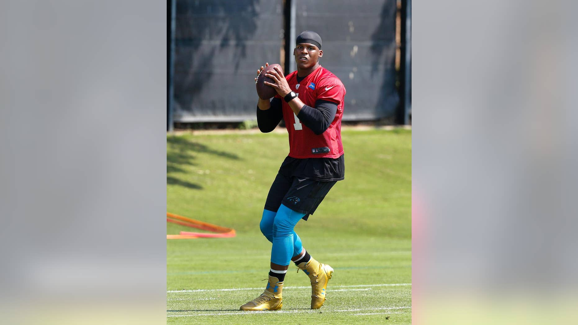 FILE - In this June 17, 2014 file photo, Carolina Panthers quarterback Cam Newton throws a pass during NFL football practice in Charlotte, N.C. Panthers coach Ron Rivera is expected to give an update on Newton's ankle on Thursday, July 24, 2014,one day before the team takes the field for the start of training camp. (AP Photo/Nell Redmond, File)