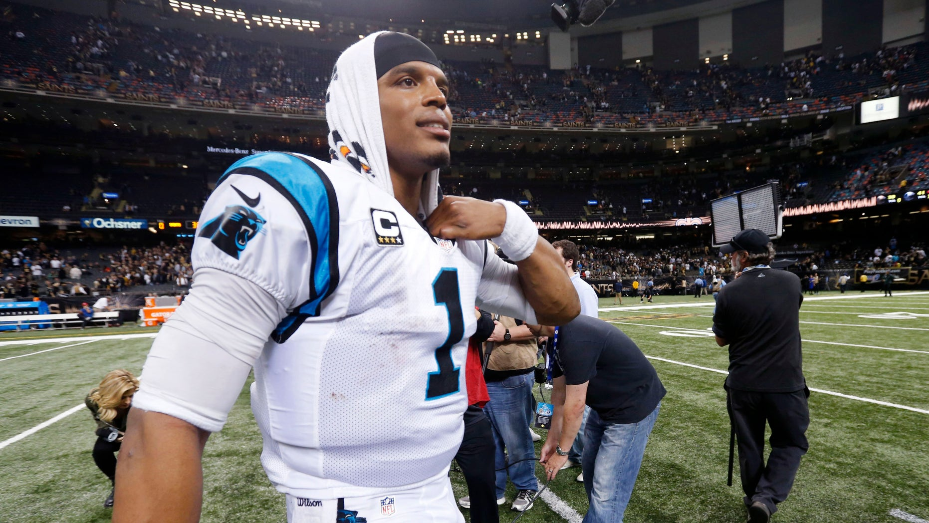 Carolina Panthers quarterback Cam Newton (1) walks on the field after an NFL football game against the New Orleans Saints in New Orleans, Sunday, Dec. 6, 2015. The Panthers won 41-38. (AP Photo/Bill Feig)