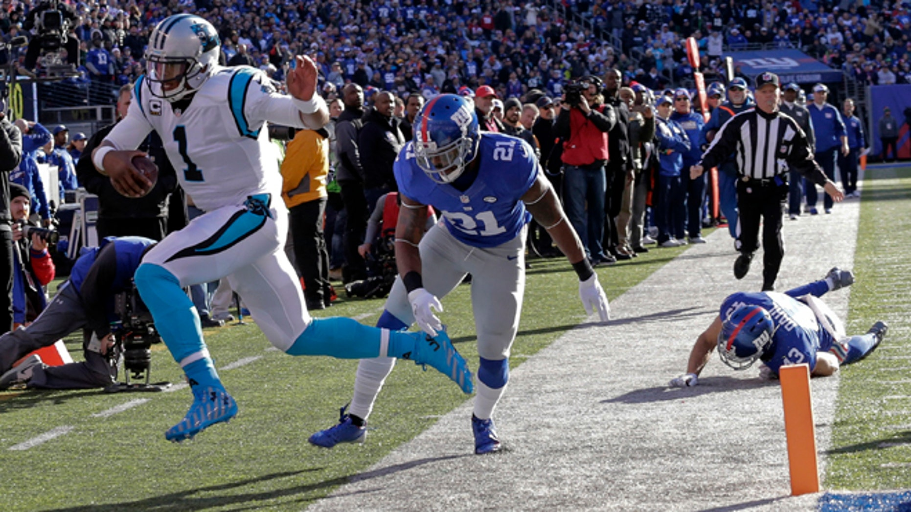 Carolina Panthers quarterback Cam Newton (1) is forced out of bounds by New York Giants' Landon Collins (21) during the first half of an NFL football game Sunday, Dec. 20, 2015, in East Rutherford, N.J. (AP Photo/Julie Jacobson)