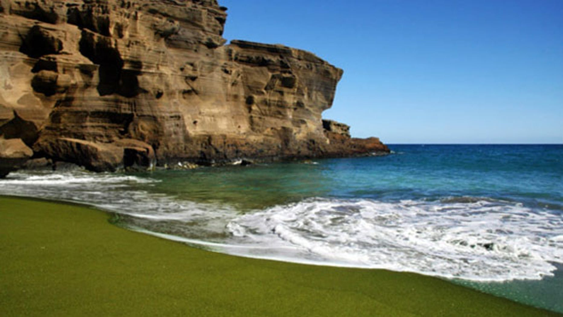Papakolea Beach in Hawaii has a green hue due to the mineral content formed from volcanic called olivine, which is one of the first crystals to form as magma cools.