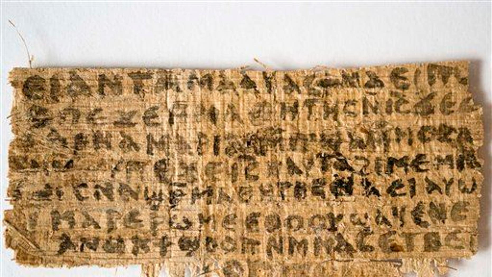 This Sept. 5, 2012, photo released by Harvard University shows the fragment.