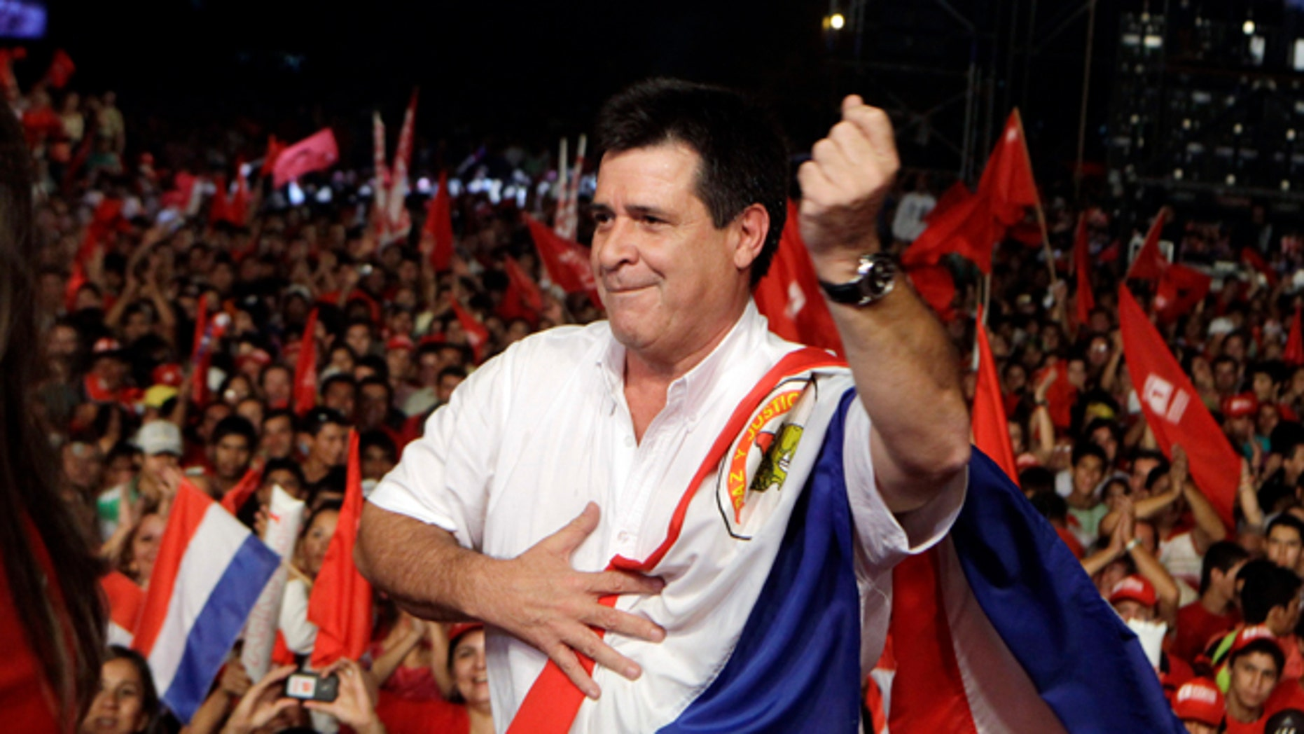 Horacio Cartes, presidential candidate of Colorado Party, dances during a campaign rally in Capiata, Paraguay, Friday, April 5, 2013. Paraguay will hold presidential elections on April 21. (AP Photo/Jorge Saenz)