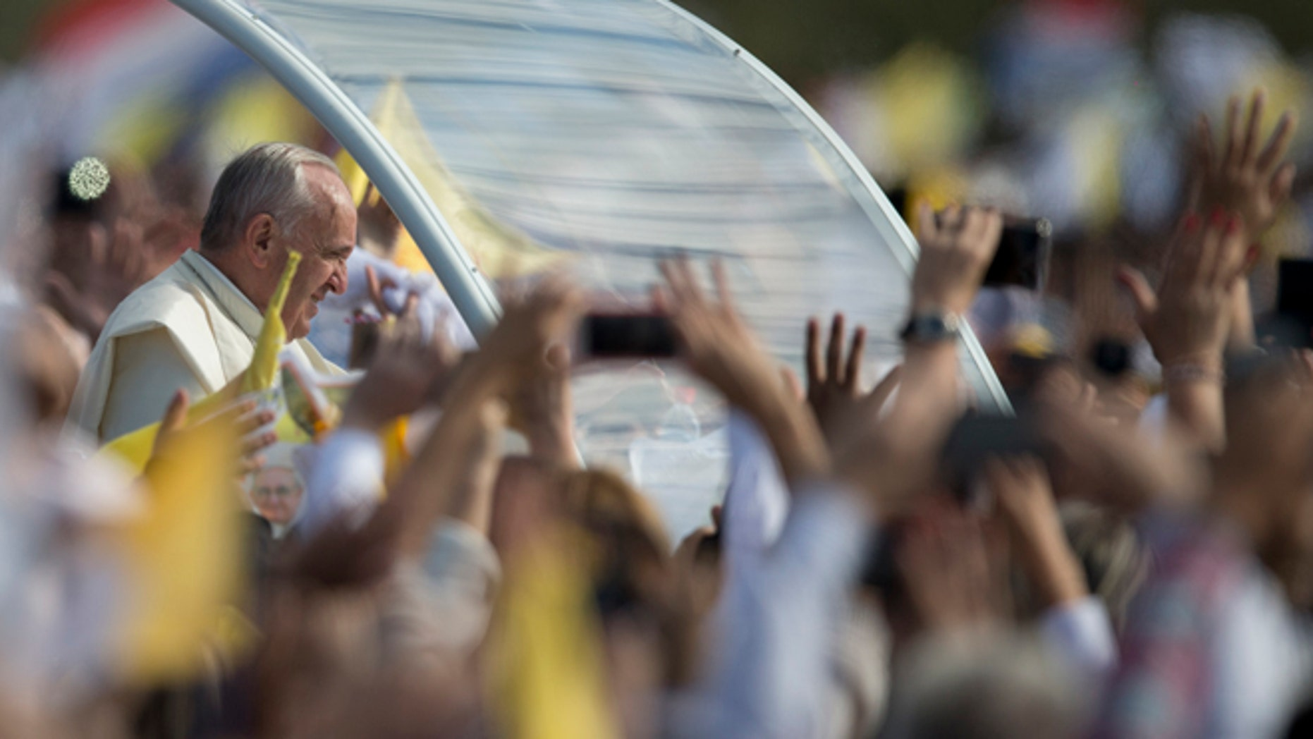 Pope Francis arrives to celebrate a mass in Asuncion, Paraguay, Sunday, July 12, 2015. The Pope arrived Friday afternoon in the Paraguayan capital of Asuncion on the final leg of his three-nation tour of South America's poorest countries that included Ecuador and neighboring Bolivia. (AP Photo/Natacha Pisarenko)