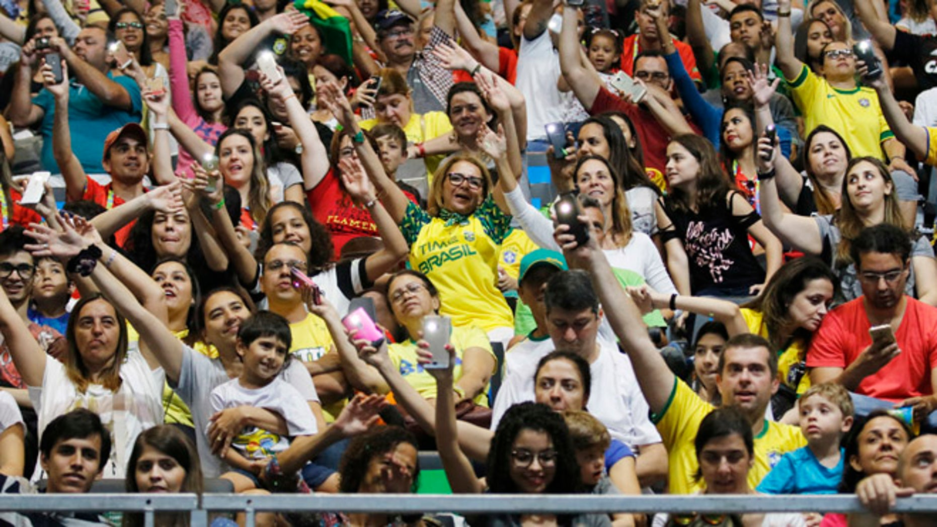 Spectators dance and cheer during the women's sitting volleyball preliminary game between Iran and the USA at the 2016 Paralympic Games in Rio de Janeiro, Brazil, Saturday, Sept. 10, 2016. Total ticket sales now sit at 1,863,000, the second-highest Paralympic Games total ever, behind London. (Jenn Finch/University of Georgia via AP)