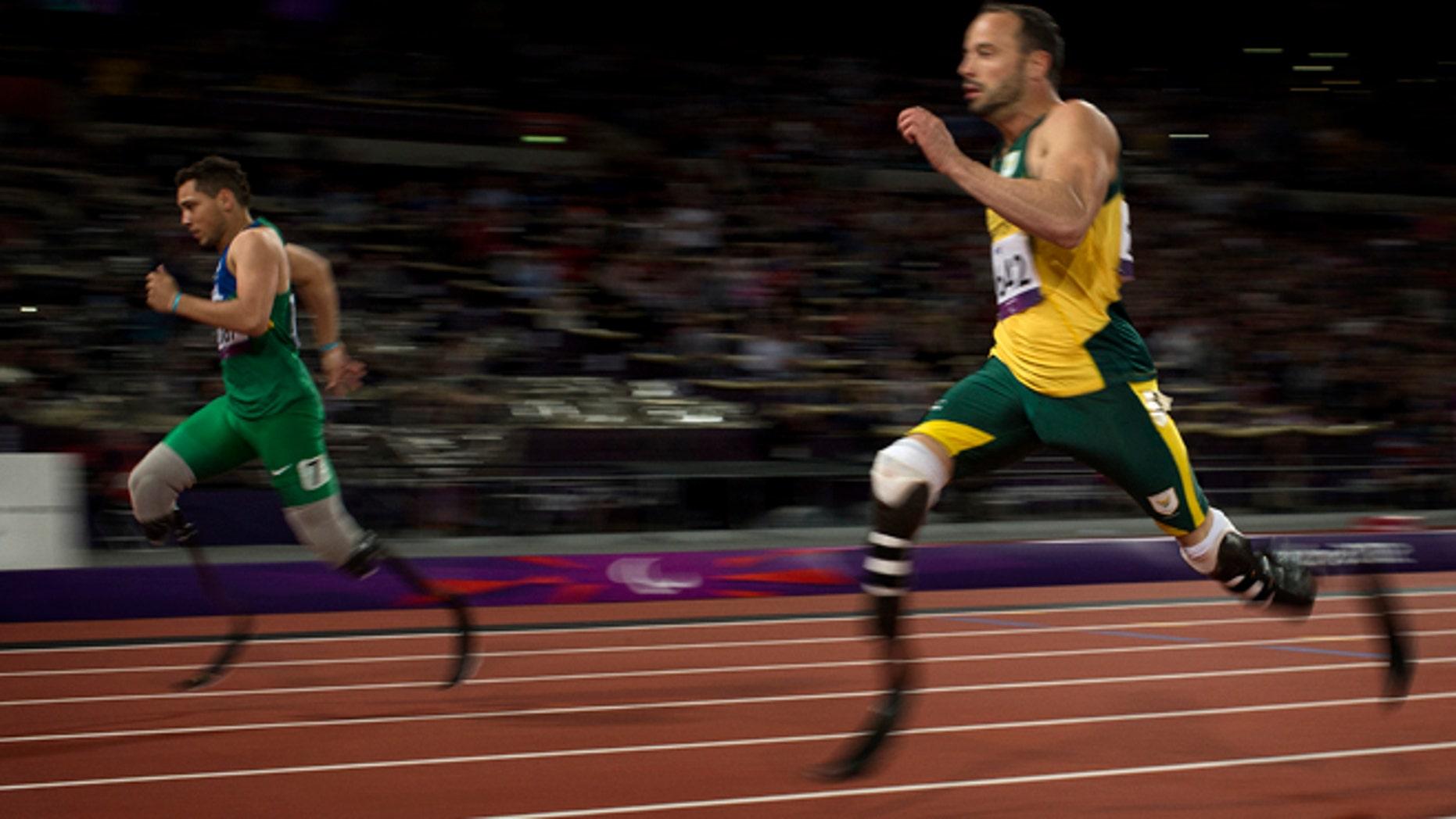 Sept. 2, 2012: Brazil's Alan Fonteles Cardoso Oliveira, left, beats South Africa's Oscar Pistorius in the 200-meter sprint at the 2012 Paralympics.