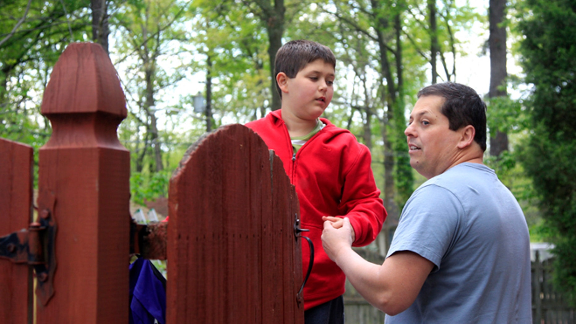 April 25, 2012: Stuart Chaifetz stands with his son Akian Chaifetz, 10, at their home in Cherry Hill, N.J.